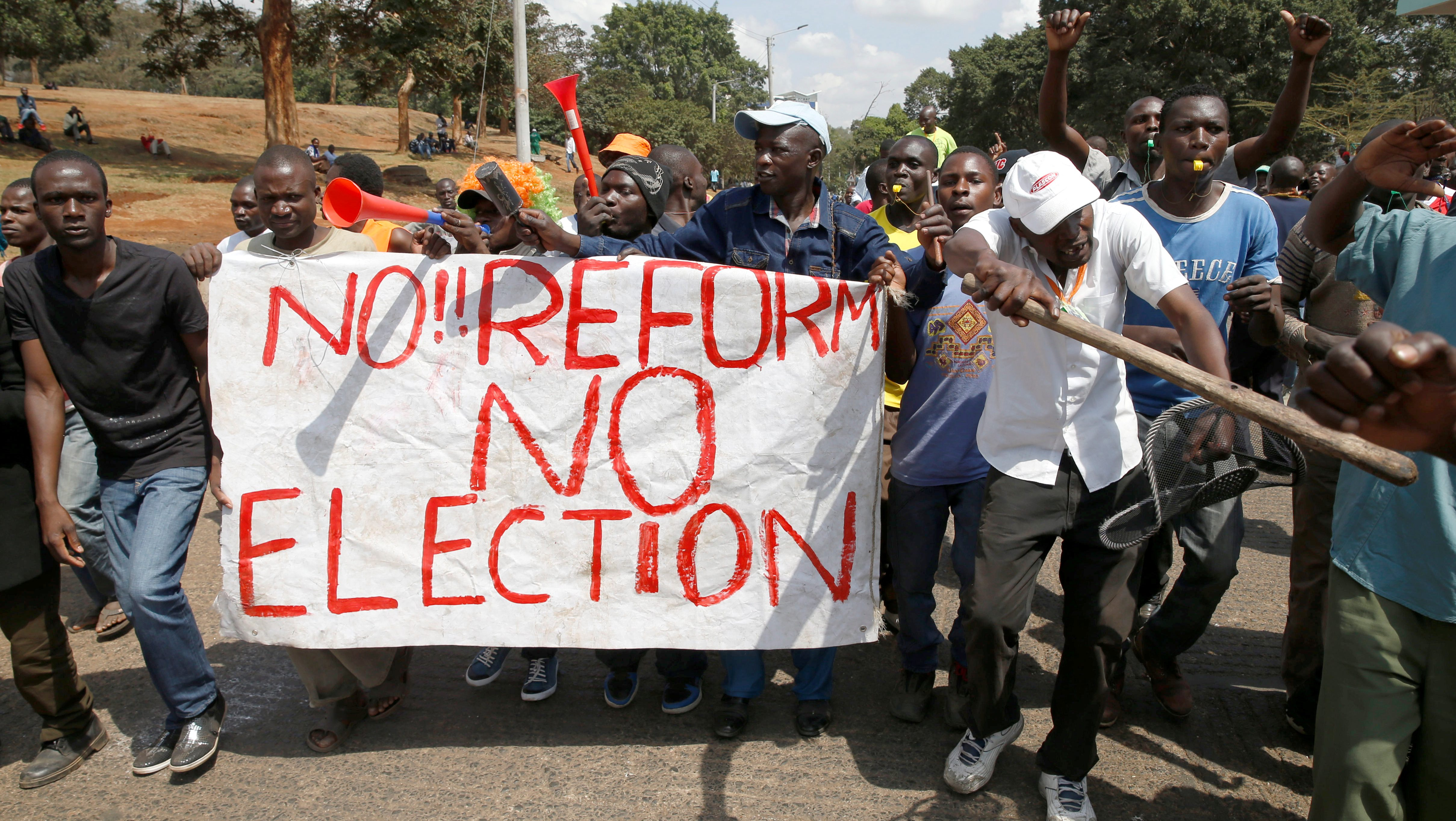 Supporters of Kenyan opposition National Super Alliance (NASA) coalition, carry a banner as they demonstrate in Nairobi, Kenya, October 11, 2017.