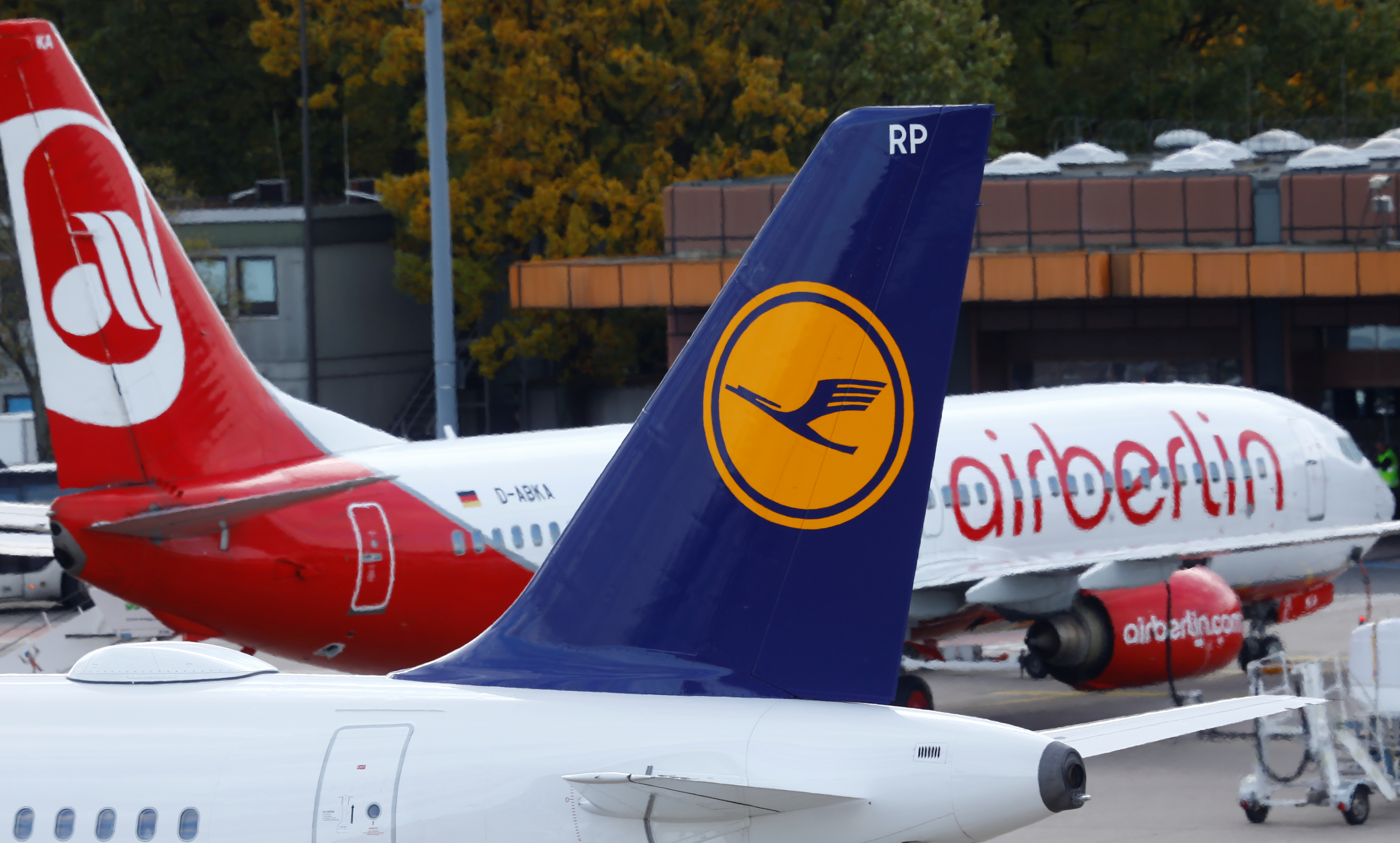 A Lufthansa airliner taxis next to the Air Berlin aircraft at Tegel airport in Berlin, Germany, October 12, 2017.