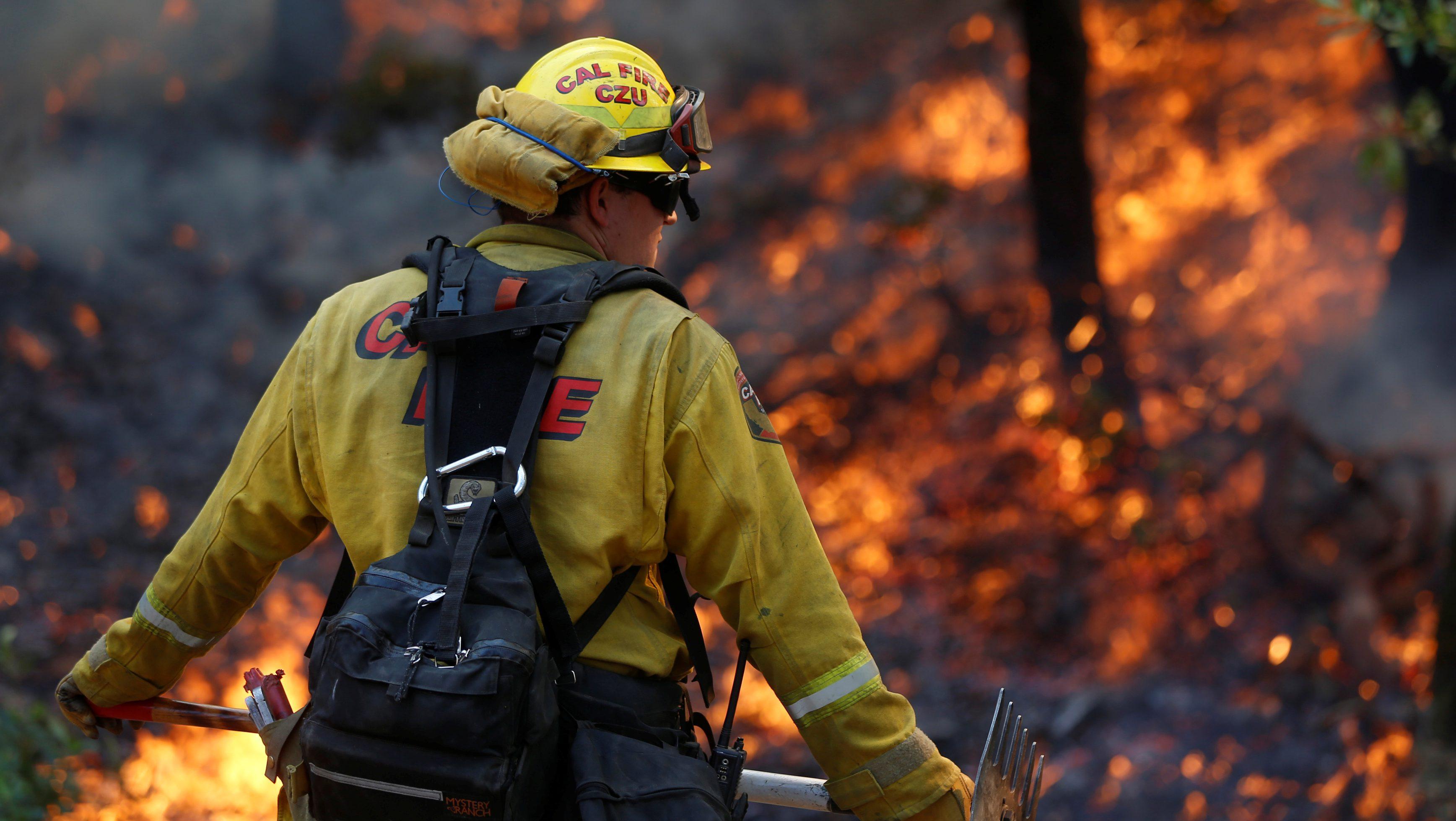 Firefighter fights a blaze in California