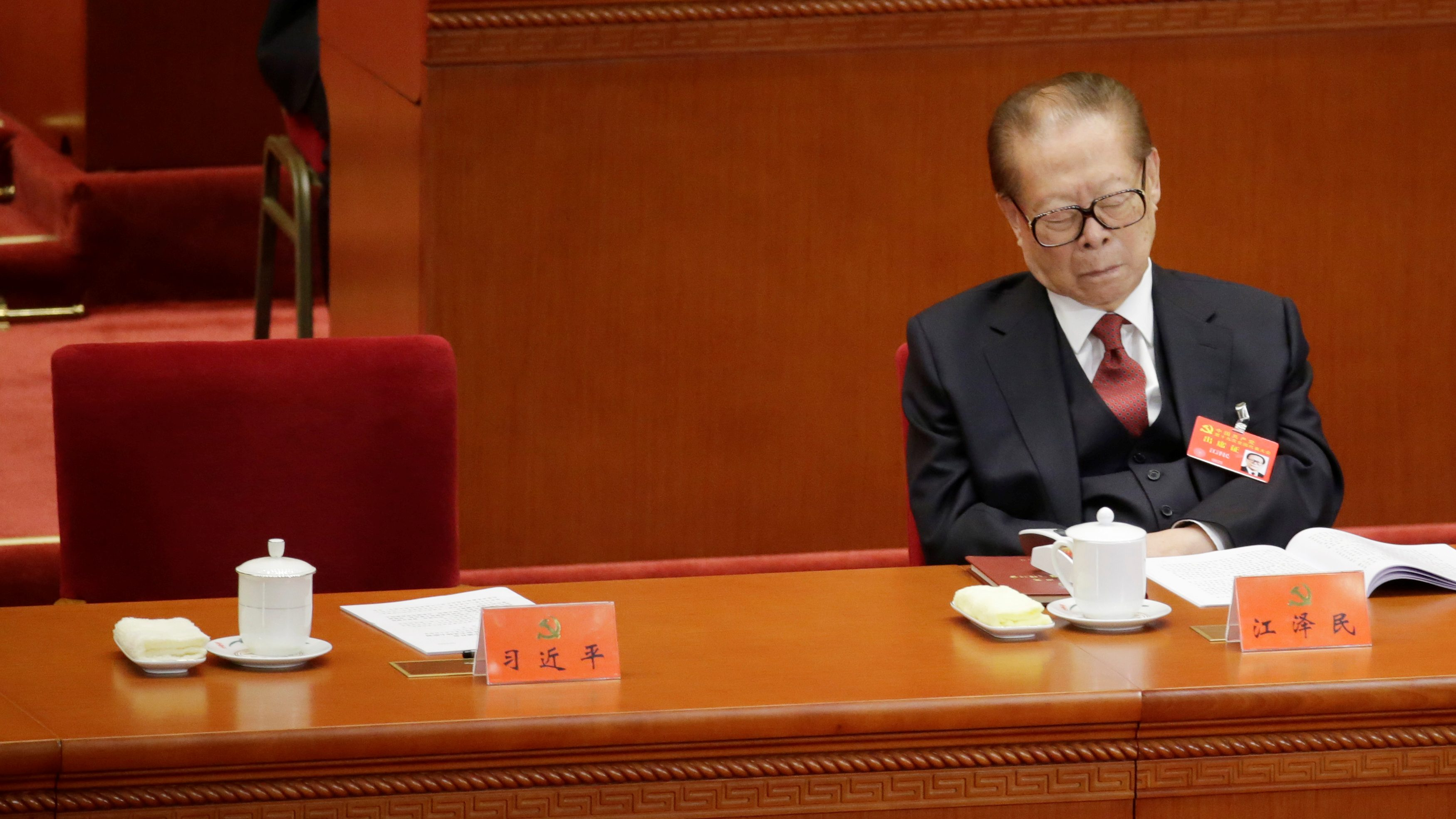 Former Chinese President Jiang Zemin takes a nap as Chinese President Xi Jinping (not pictured) delivers his speech during the opening session of the 19th National Congress of the Communist Party of China at the Great Hall of the People in Beijing, China October 18, 2017.