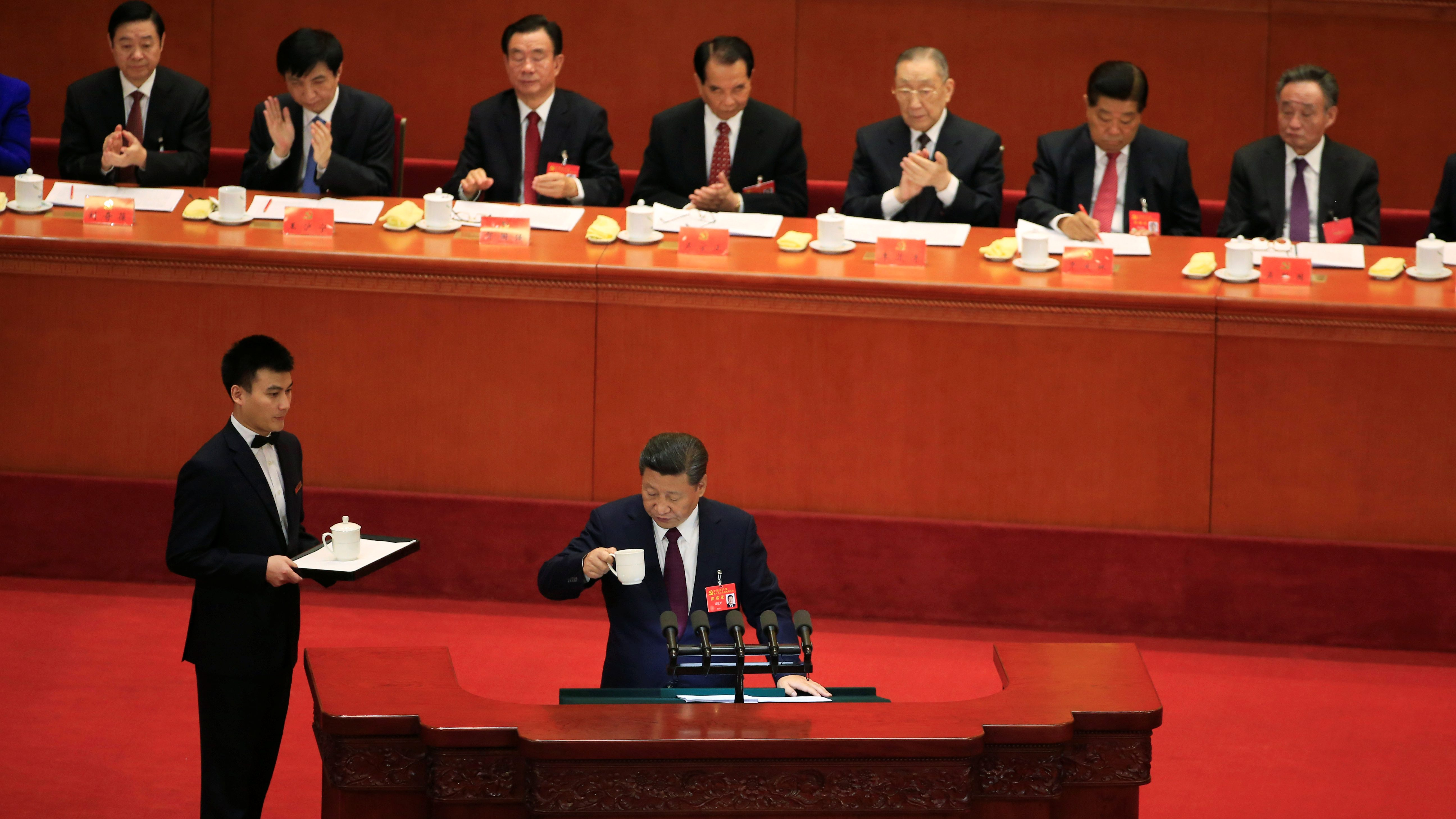 Chinese President Xi Jinping is served tea as he delivers a speech during the opening session of the 19th National Congress of the Communist Party of China at the Great Hall of the People in Beijing, China October 18, 2017.
