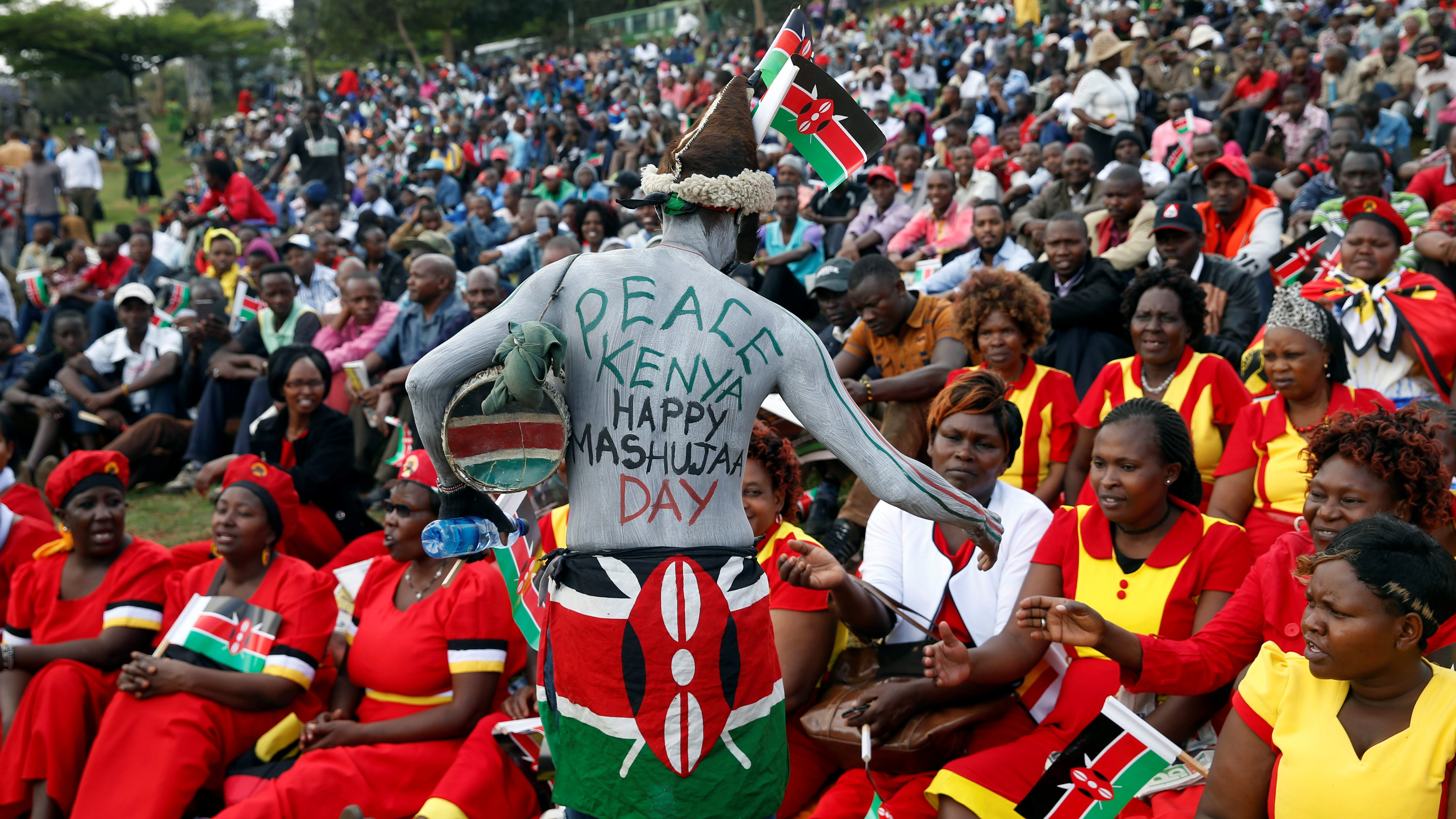 A man walks through the crowd during the country's Mashujaa Day (Heroes' Day) celebrations at the Uhuru park in Nairobi, Kenya