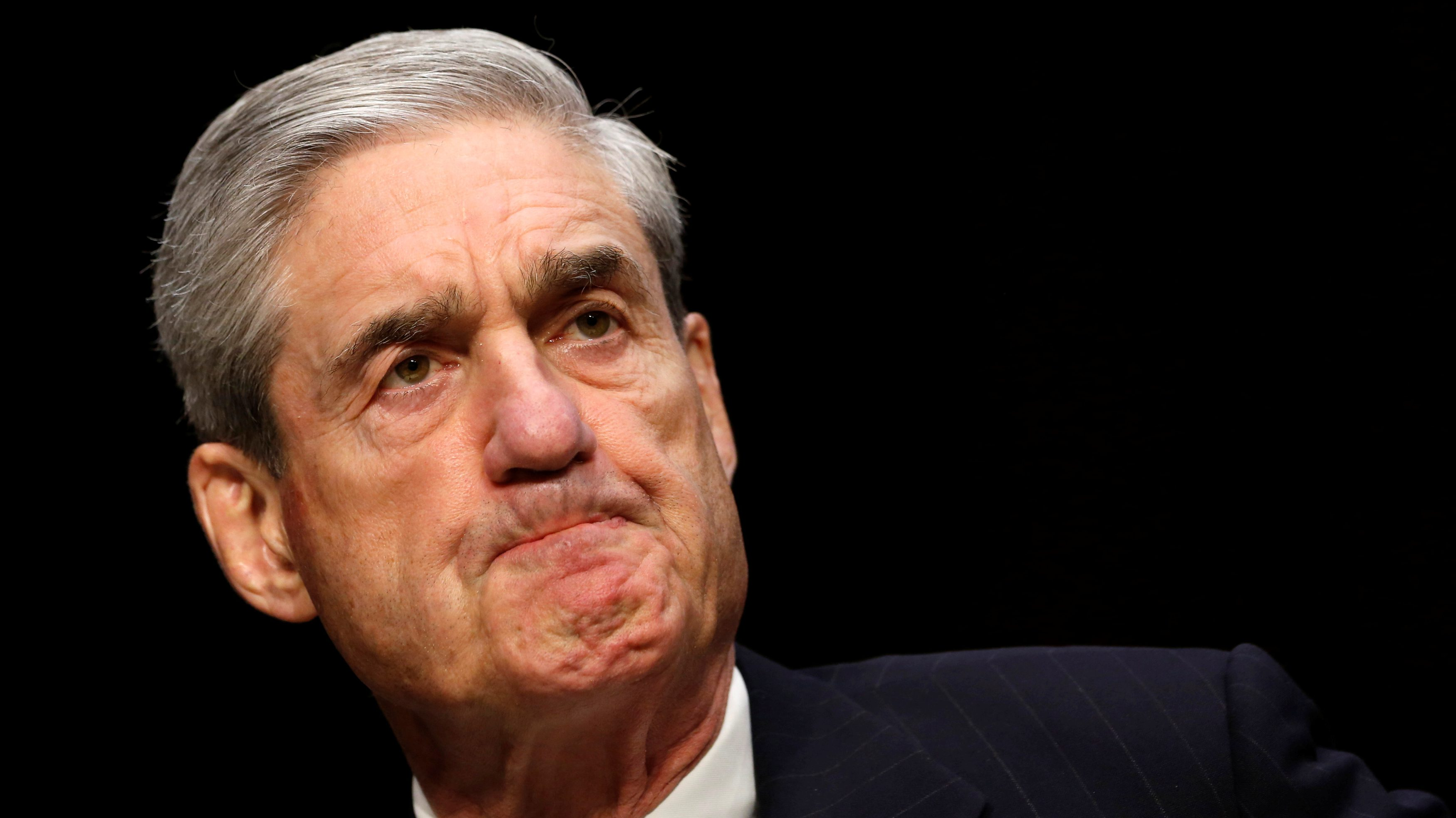 """FBI Director Robert Mueller testifies before a Senate Intelligence Committee hearing on """"Current and Projected National Security Threats to the United States"""" on Capitol Hill in Washington March 12, 2013. REUTERS/Kevin Lamarque/File Photo - RC19BC634000"""
