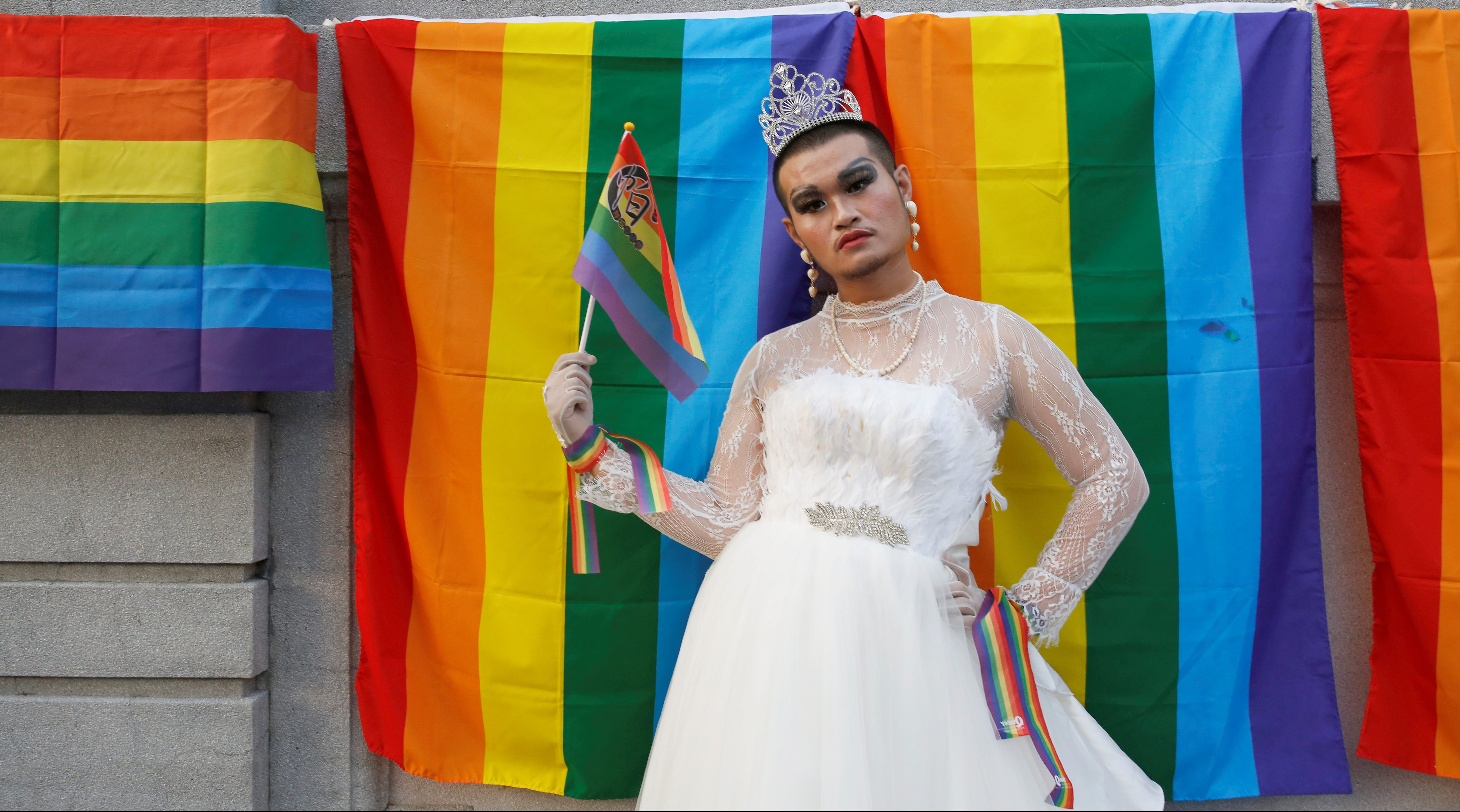 A participant wearing wedding dress takes part in a lesbian, gay, bisexual and transgender (LGBT) pride parade in Taipei
