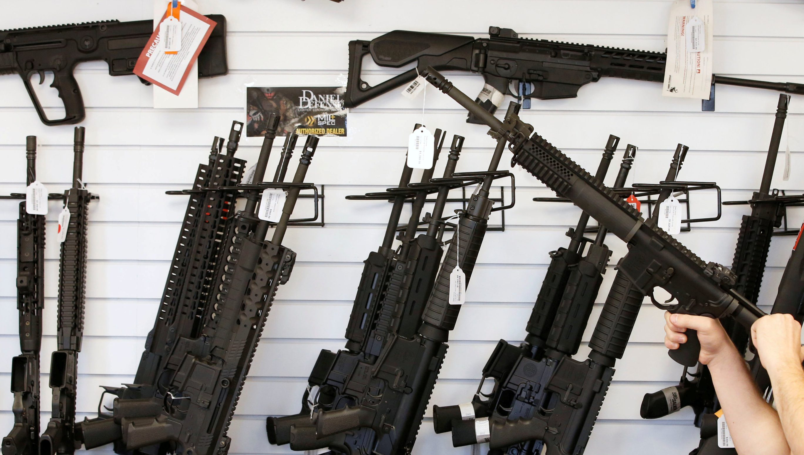 """Salesman Ryan Martinez clears the chamber of an AR-15 at the """"Ready Gunner"""" gun store In Provo, Utah, U.S. in Provo, Utah, U.S., June 21, 2016. Massachusetts will ban the sale of """"copycat"""" assault-style weapons similar to those increasingly used in mass shootings, state Attorney General Maura Healey, said July 20, 2016. REUTERS/George Frey/File Photo - TM3EC7K1DK101"""