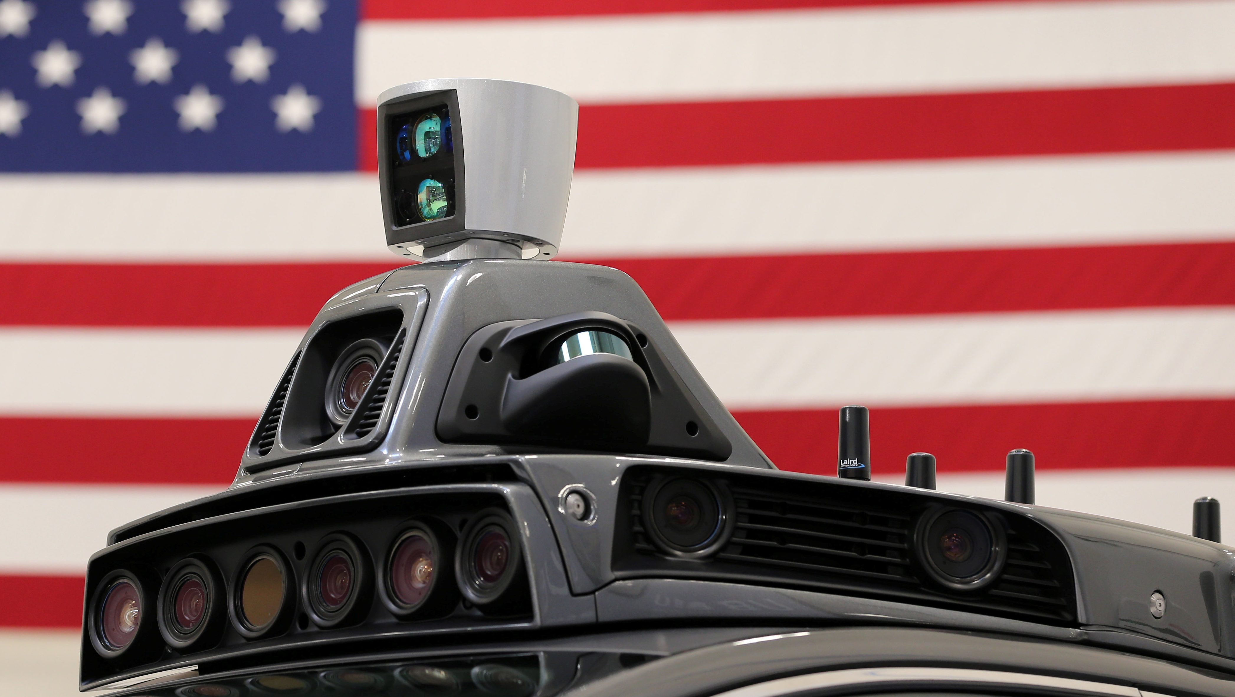 A roof mounted camera and radar system is shown on Uber's Ford Fusion self driving car during a demonstration of self-driving automotive technology in Pittsburgh, Pennsylvania, U.S. September 13, 2016. REUTERS/Aaron Josefczyk - S1BEUBFRVFAB