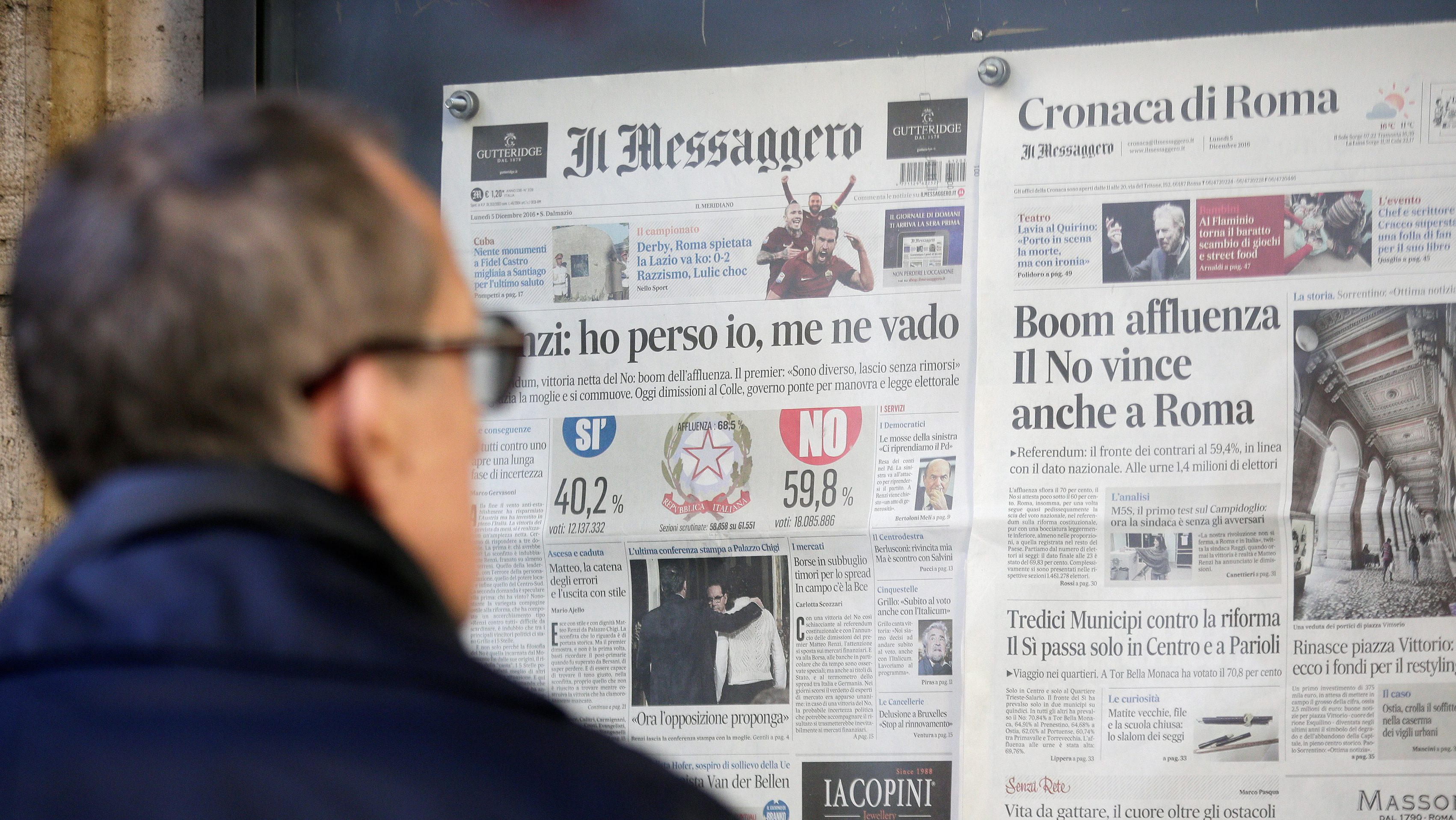 A man reads the Messaggero newspaper in a showcase outside the Messaggero headquarters in Rome, Italy, December 5, 2016. REUTERS/Max Rossi - RC1F3F14F040