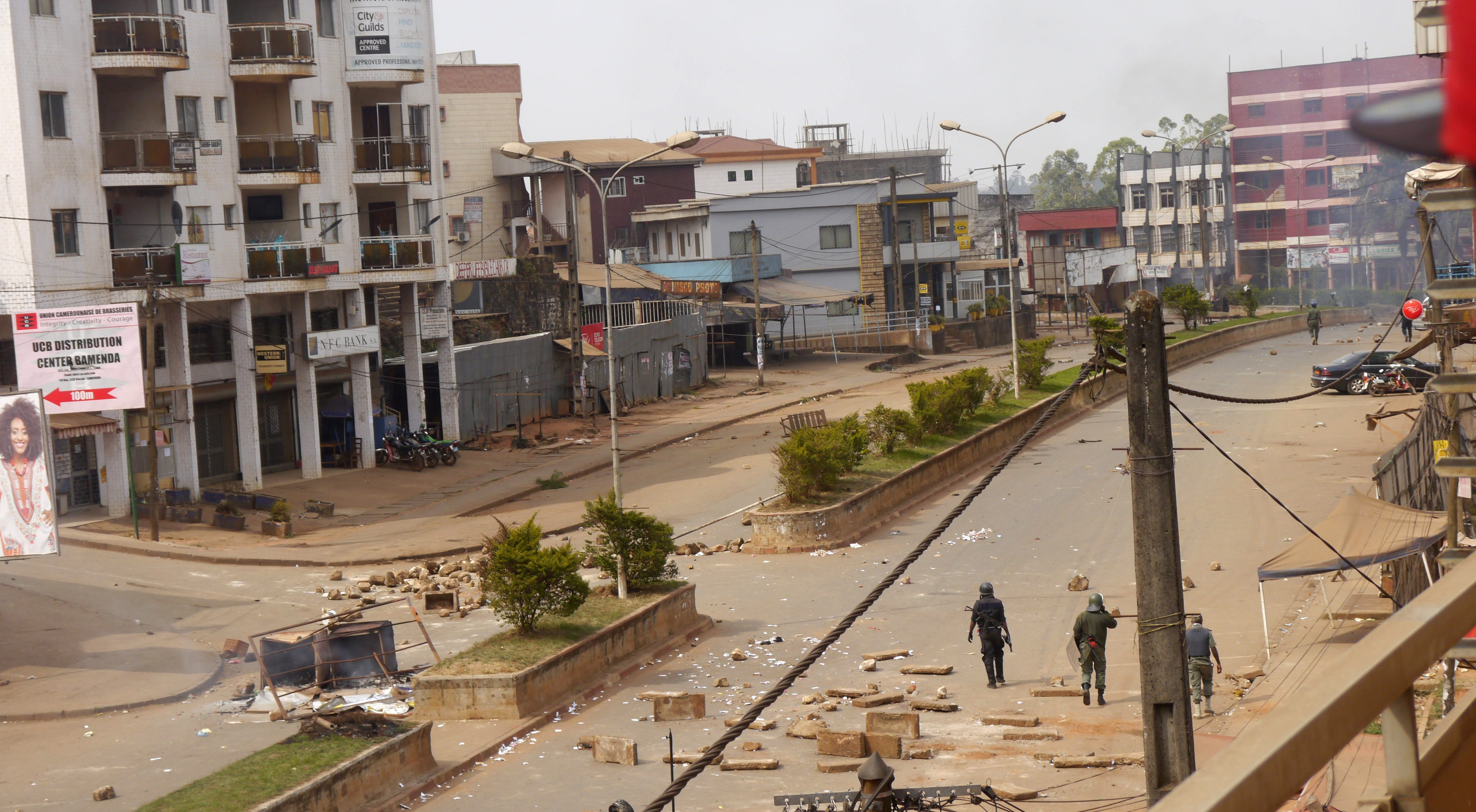 Soldiers clear a road in Bamenda