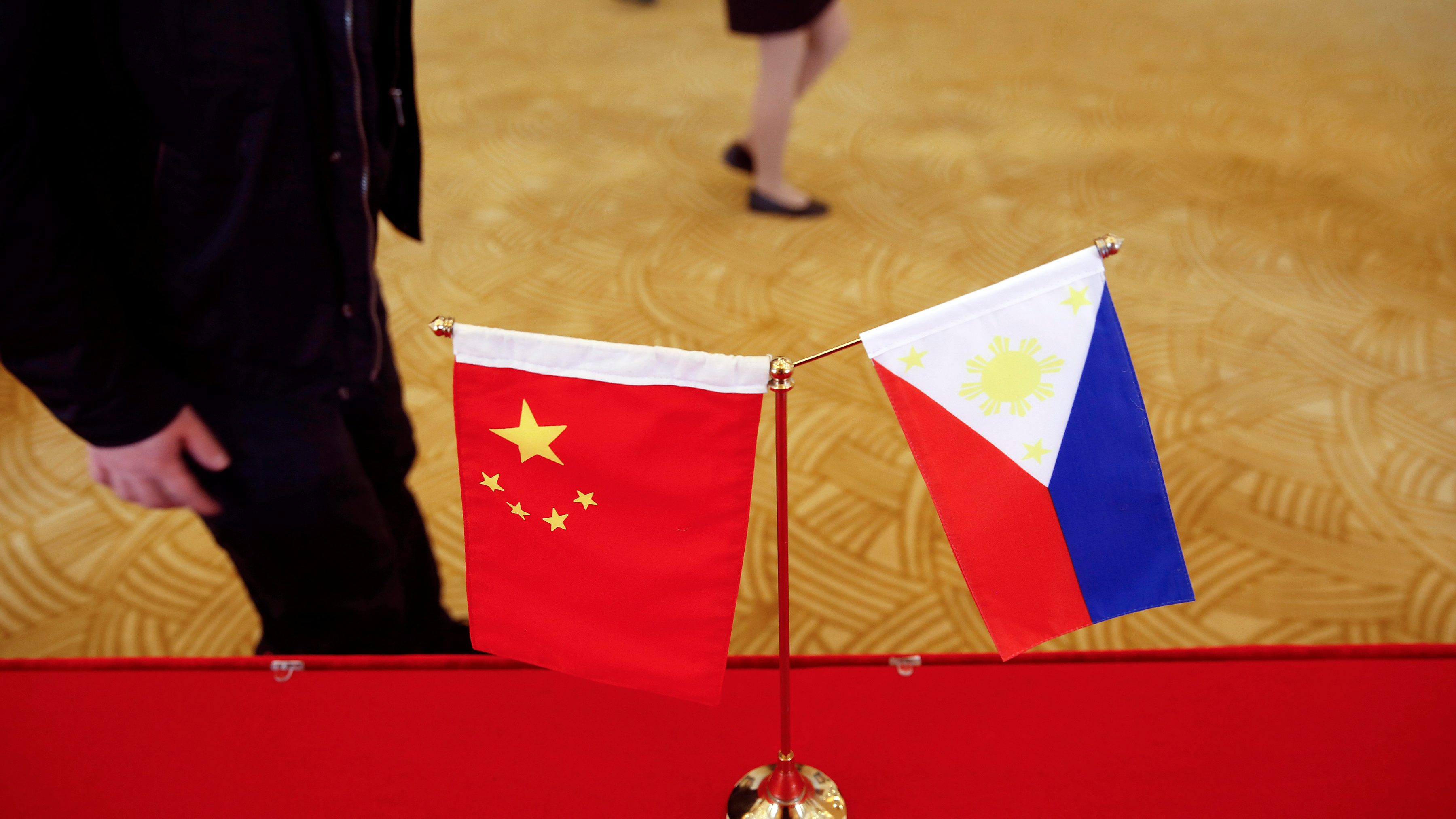 National flags are placed outside a room where Philippine Finance Secretary Carlos Dominguez and China's Commerce Minister Gao Hucheng address reporters after their meeting in Beijing, China, January 23, 2017.