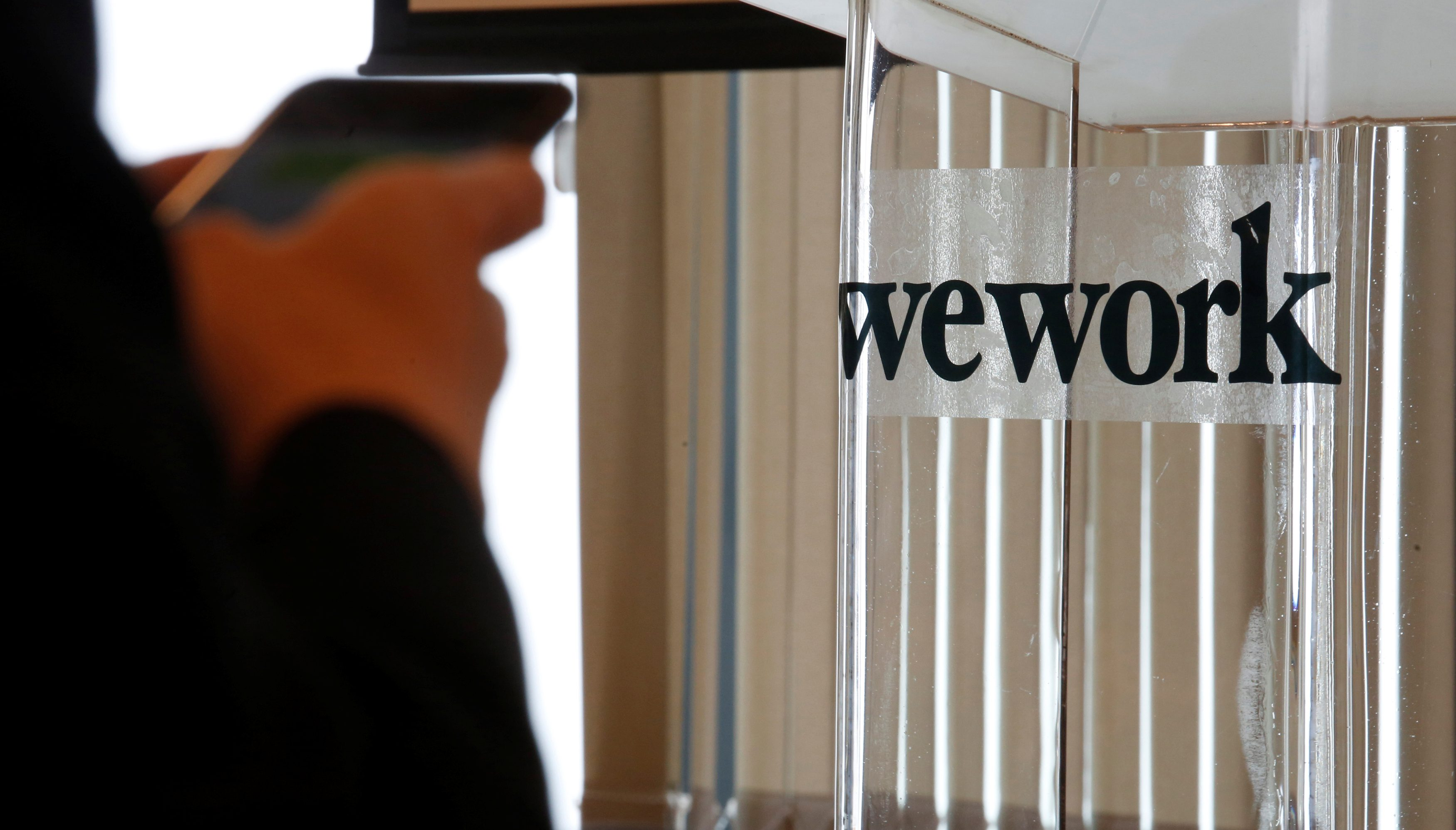 A guest attends the opening ceremony of WeWork Hong Kong flagship location in Hong Kong, China February 23, 2017. REUTERS/Bobby Yip - RC1FDE487F00