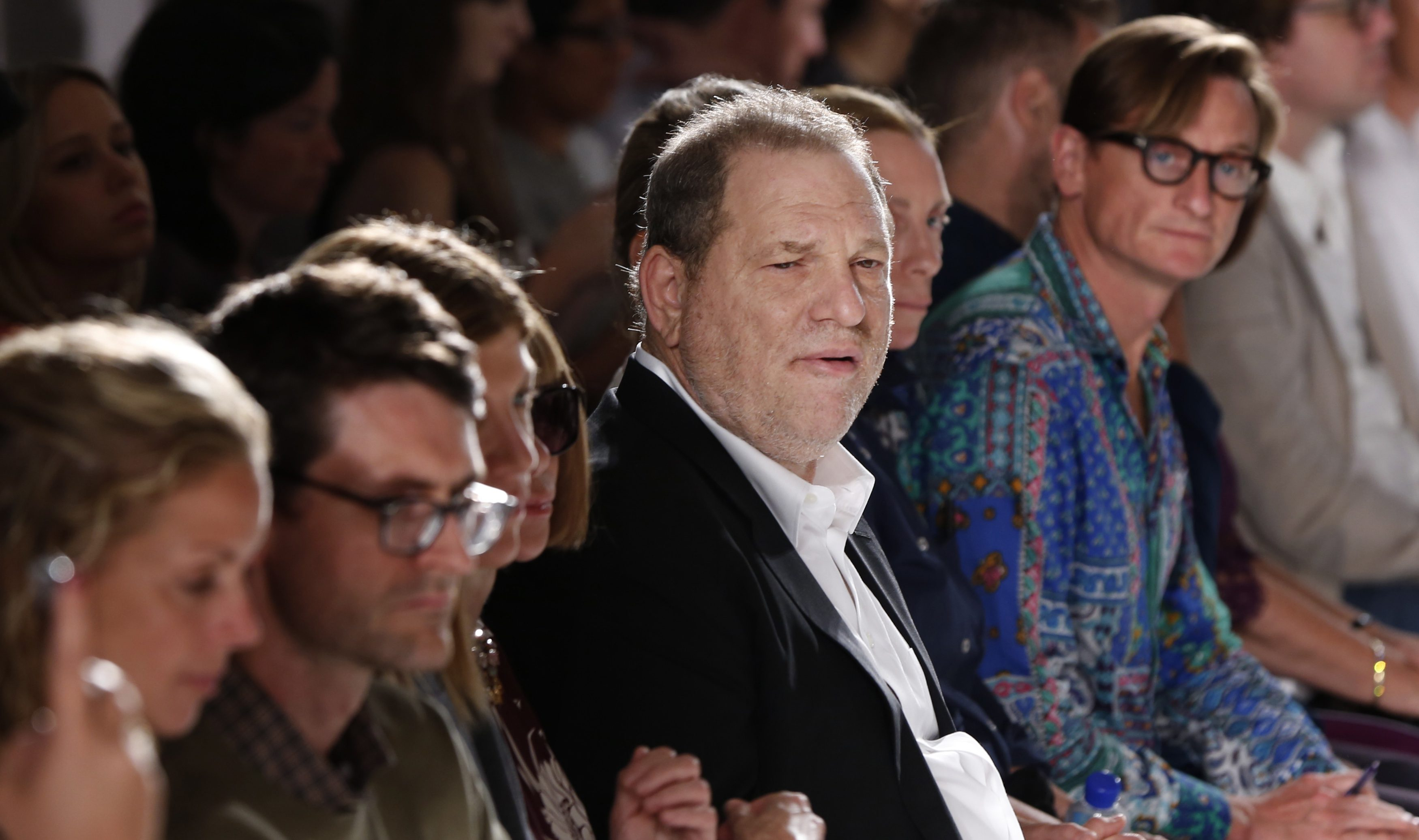 Director Harvey Weinstein (C) watches models present the Marchesa Spring/Summer 2014 collection during New York Fashion Week September 11, 2013. REUTERS/Lucas Jackson (UNITED STATES - Tags: FASHION ENTERTAINMENT) - GM1E99C0IL201Director Harvey Weinstein (C) watches models present the Marchesa Spring/Summer 2014 collection during New York Fashion Week September 11, 2013. REUTERS/Lucas Jackson (UNITED STATES - Tags: FASHION ENTERTAINMENT) - GM1E99C0IL201