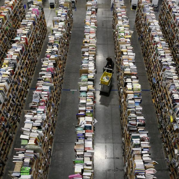 A worker gathers items for delivery from the warehouse floor at Amazon's distribution center in Phoenix, Arizona November 22, 2013. The web-based retailer is preparing for Cyber Monday, which is traditionally the busiest day of the year for online purchases, and falls on December 2 in 2013.