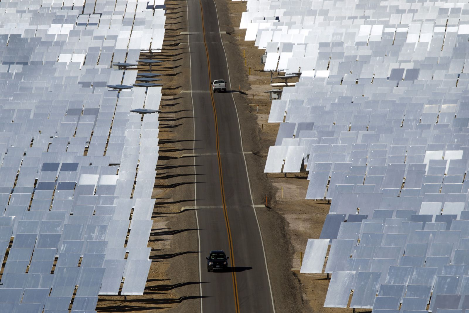 A field of heliostats (mirrors that track the sun and reflect the sunlight onto a central receiving point) at the Ivanpah Solar Electric Generating System in Nipton.