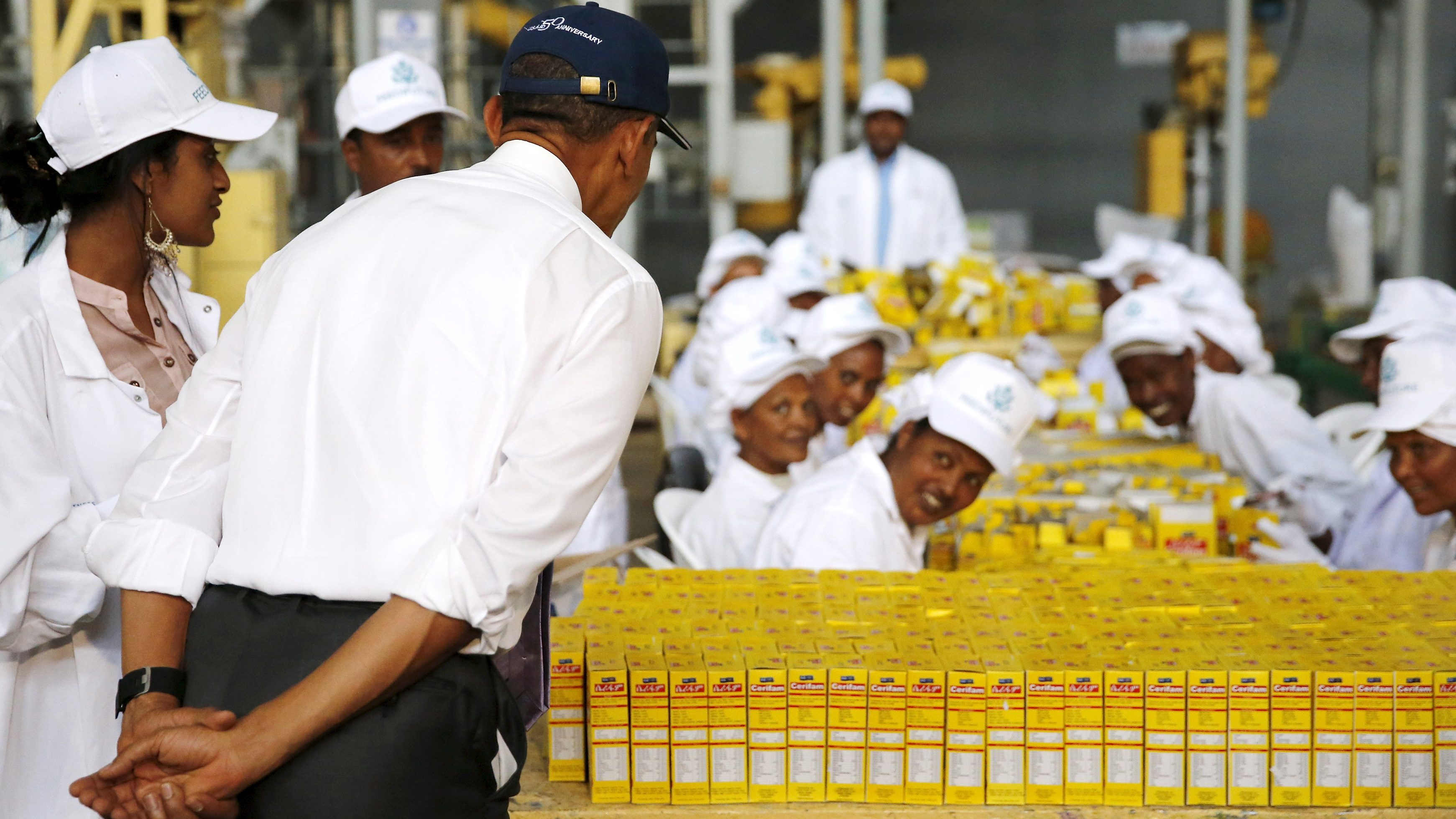 Obama bows as he greets workers during a tour of the Faffa Food factory in Addis Ababa, Ethiopia