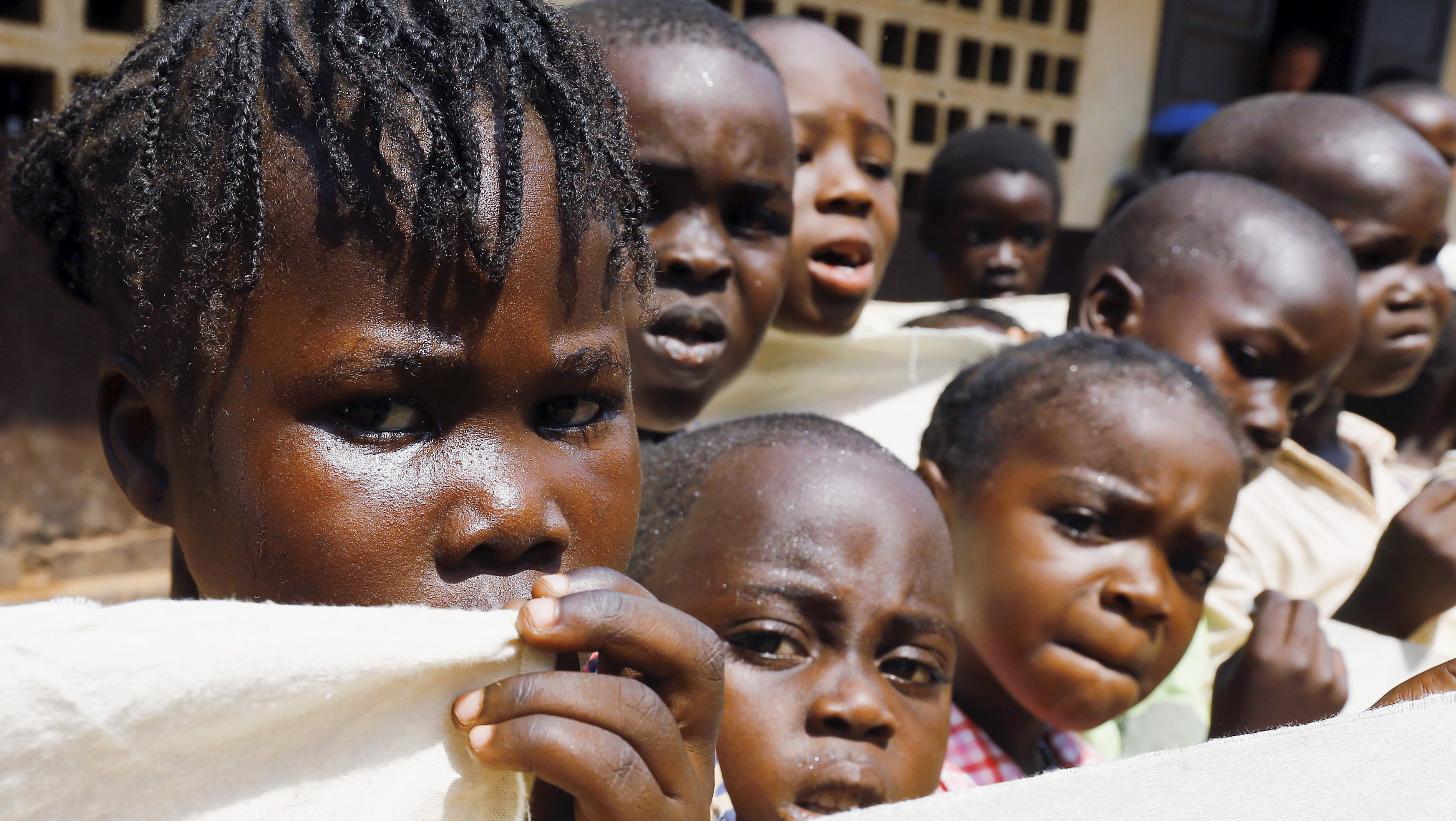 Children look on before Pope Francis' visit to the refugee camp of Saint Sauveur in the capital Bangui