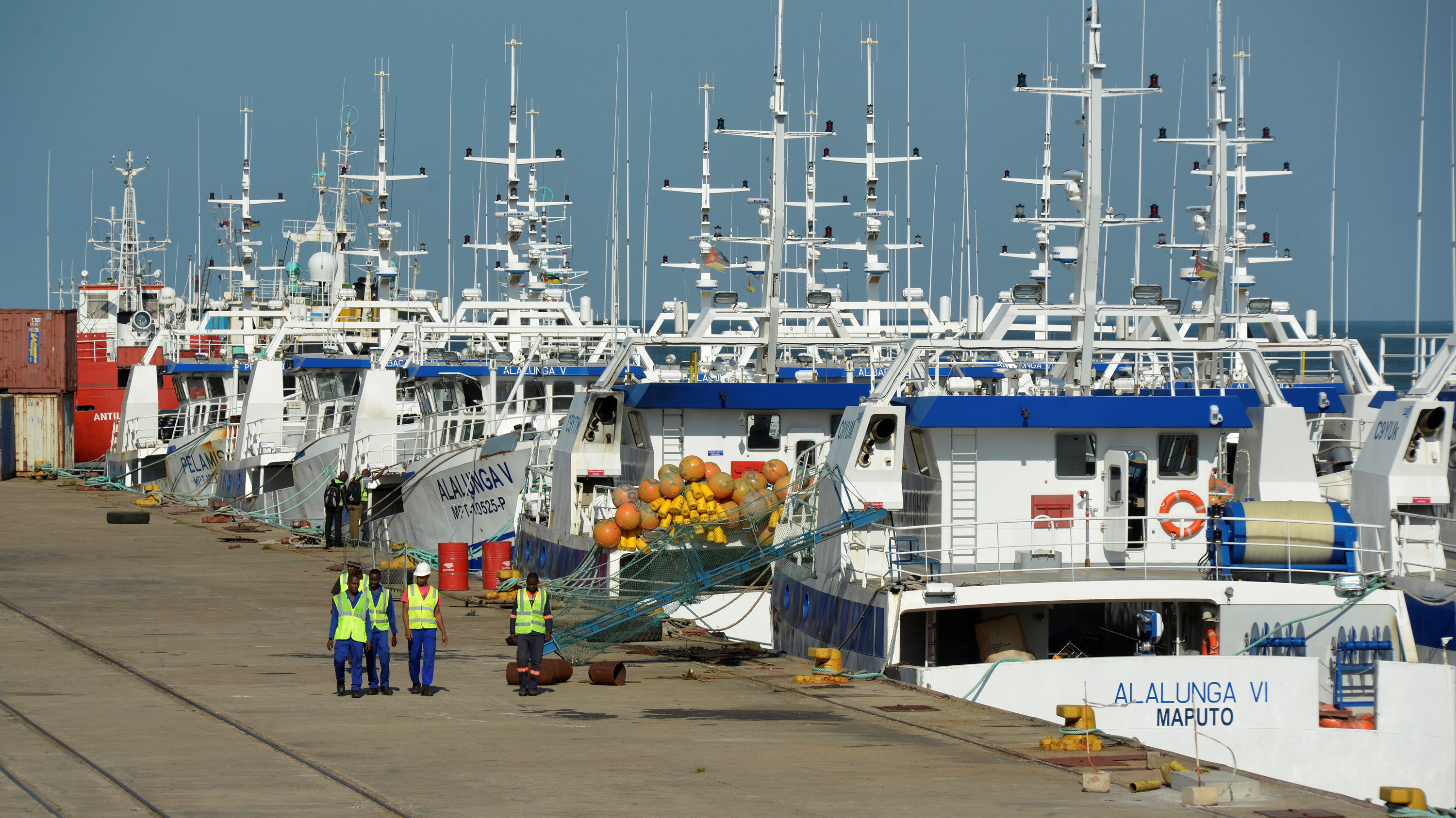 Security guards patrol past the EMATUM fishing fleet docked in Maputo