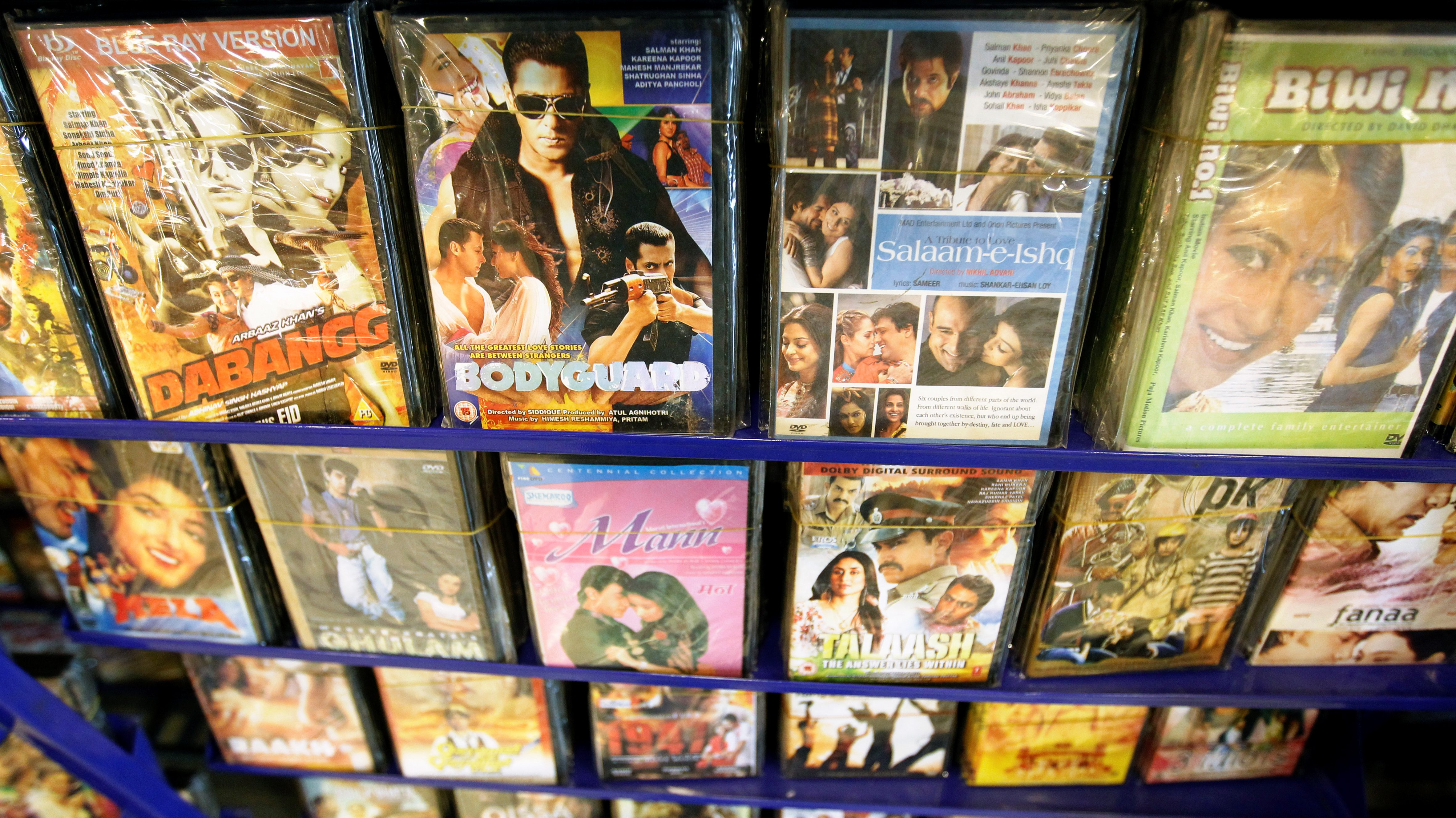 Bollywood movies are seen on display at a video store in Islamabad, Pakistan October 20, 2016. REUTERS/Caren Firouz - S1BEUIBADDAA