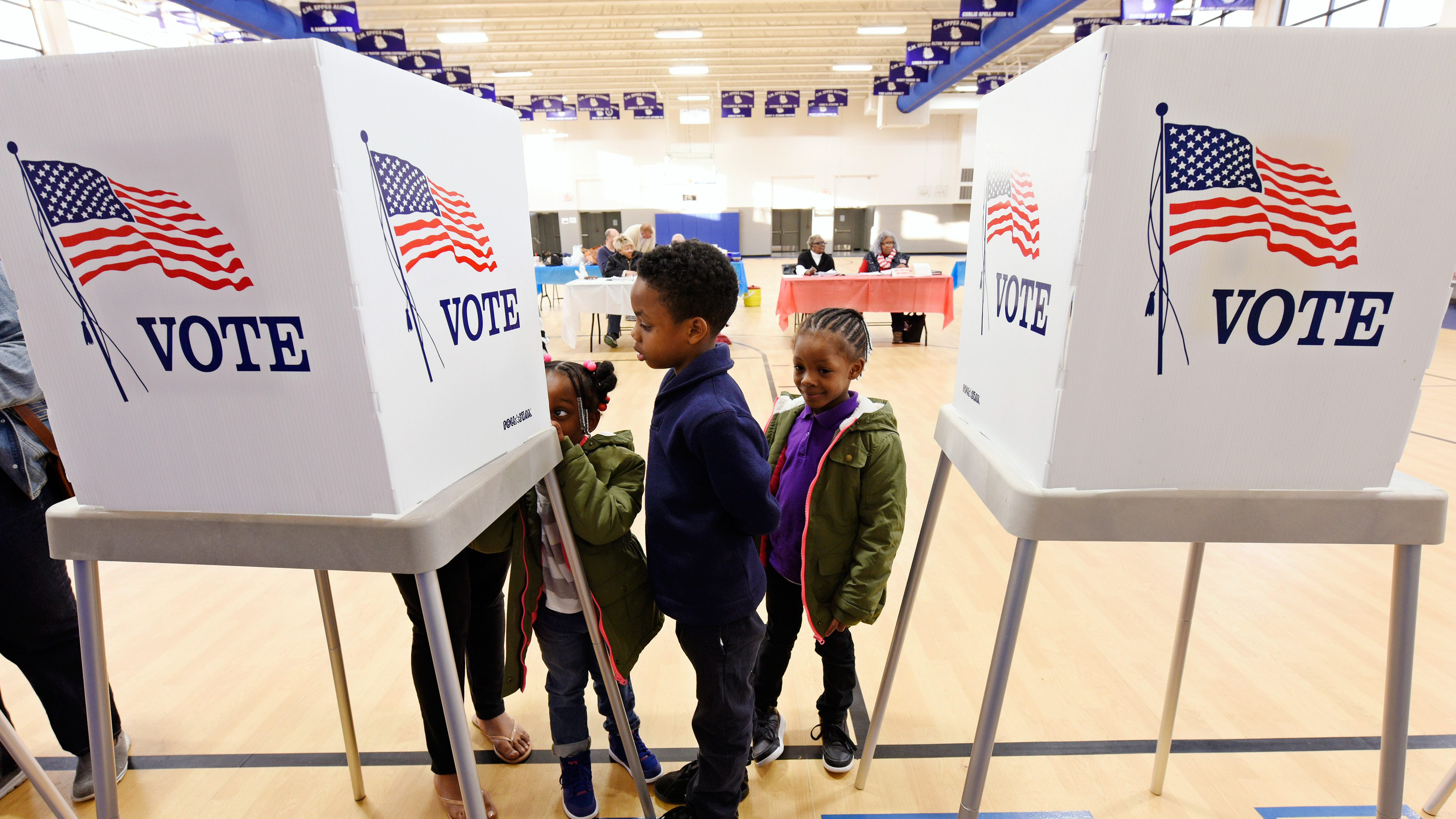 Children watch their mother vote during the U.S. general election in Greenville, North Carolina, U.S. on November 8, 2016.  REUTERS/Jonathan Drake - HT1ECB81PYVBM