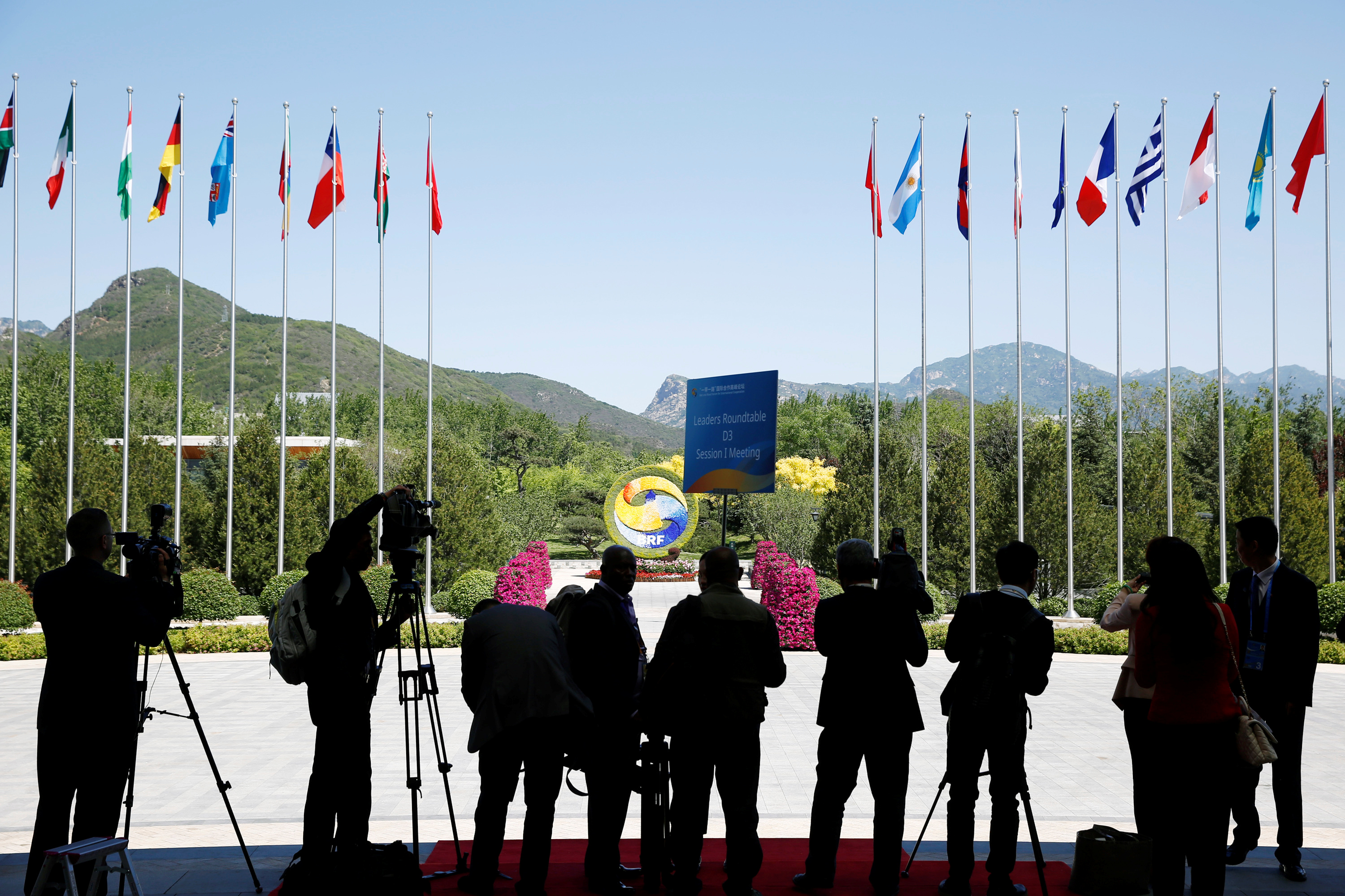 Journalist take pictures outside the venue of a summit at the Belt and Road Forum in Beijing, China, May 15, 2017.