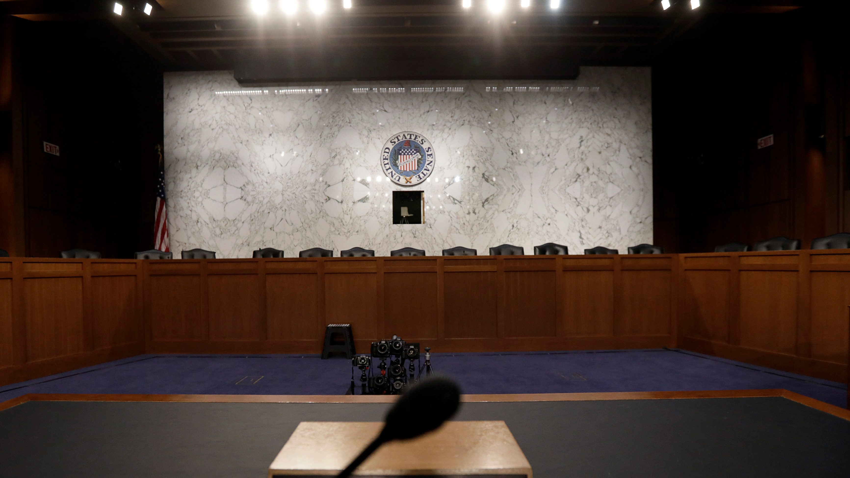 The witness table where former FBI Director James Comey will face the U.S. Senate Intelligence Committee and testify on June 8 about his meetings with President Trump sits at the ready in Washington, U.S., June 7, 2017.  REUTERS/Jim Bourg     TPX IMAGES OF THE DAY - RC11ECE08270