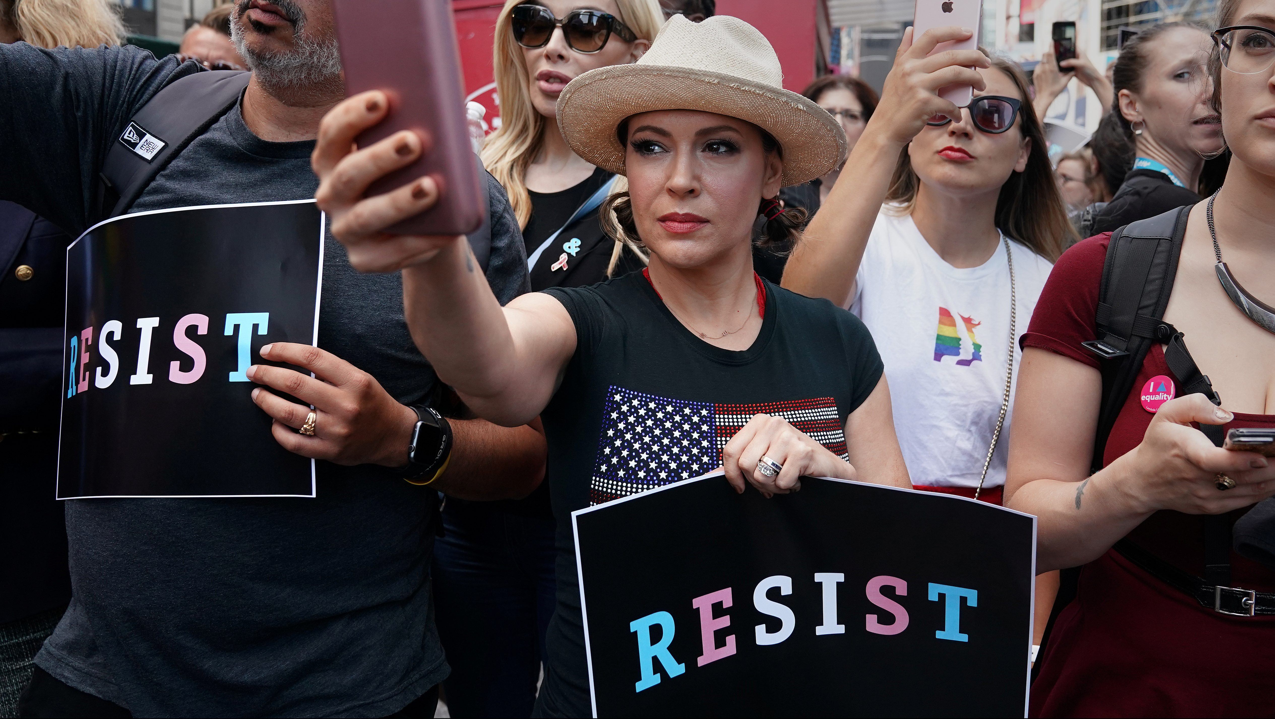 Actress Alyssa Milano attends a protest against U.S. President Donald Trump's announcement that he plans to reinstate a ban on transgender individuals from serving in any capacity in the U.S. military, in Times Square, in New York City, New York, U.S., July 26, 2017.