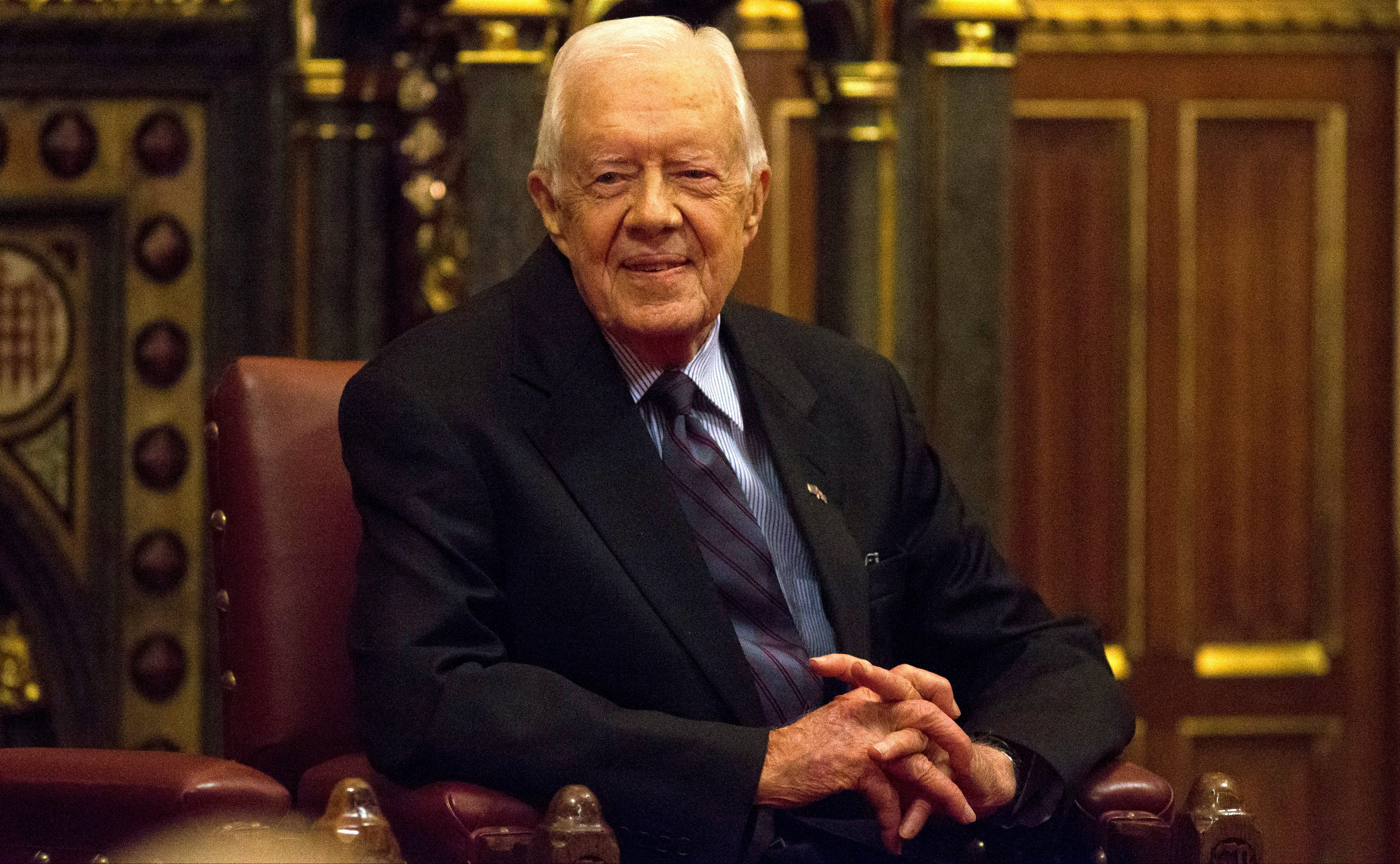 FILE PHOTO - Former U.S. President Jimmy Carter sits after delivering a lecture on the eradication of the Guinea worm, at the House of Lords in London, Britain February 3, 2016.