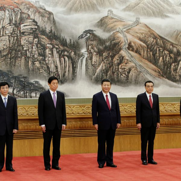 China's new Politburo Standing Committee members (from L to R) Han Zheng, Wang Huning, Li Zhanshu, Xi Jinping, Li Keqiang, Wang Yang and Zhao Leji, line up as they meet with the press at the Great Hall of the People in Beijing,ÊChina October 25, 2017.   REUTERS/Jason Lee - RC1510553400