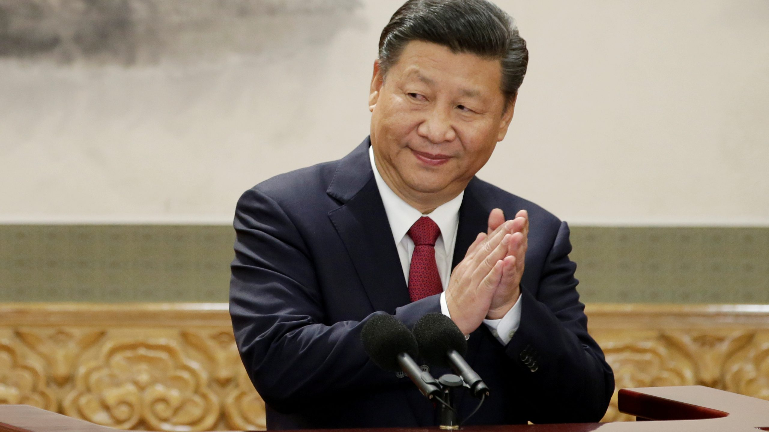 China's President Xi Jinping claps after his speech as he and other new Politburo Standing Committee members meet with the press at the Great Hall of the People in Beijing,China October 25, 2017.  REUTERS/Jason Lee     TPX IMAGES OF THE DAY - RC1CA251AF60