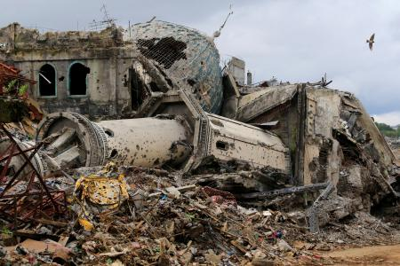 Damaged houses, buildings and a mosque are seen in Marawi city, Philippines, October 25, 2017.