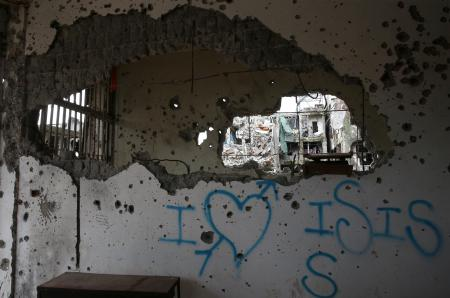 """A graffiti that reads """"I love ISIS"""" is seen in a damaged building in Marawi city, Philippines, October 25, 2017."""