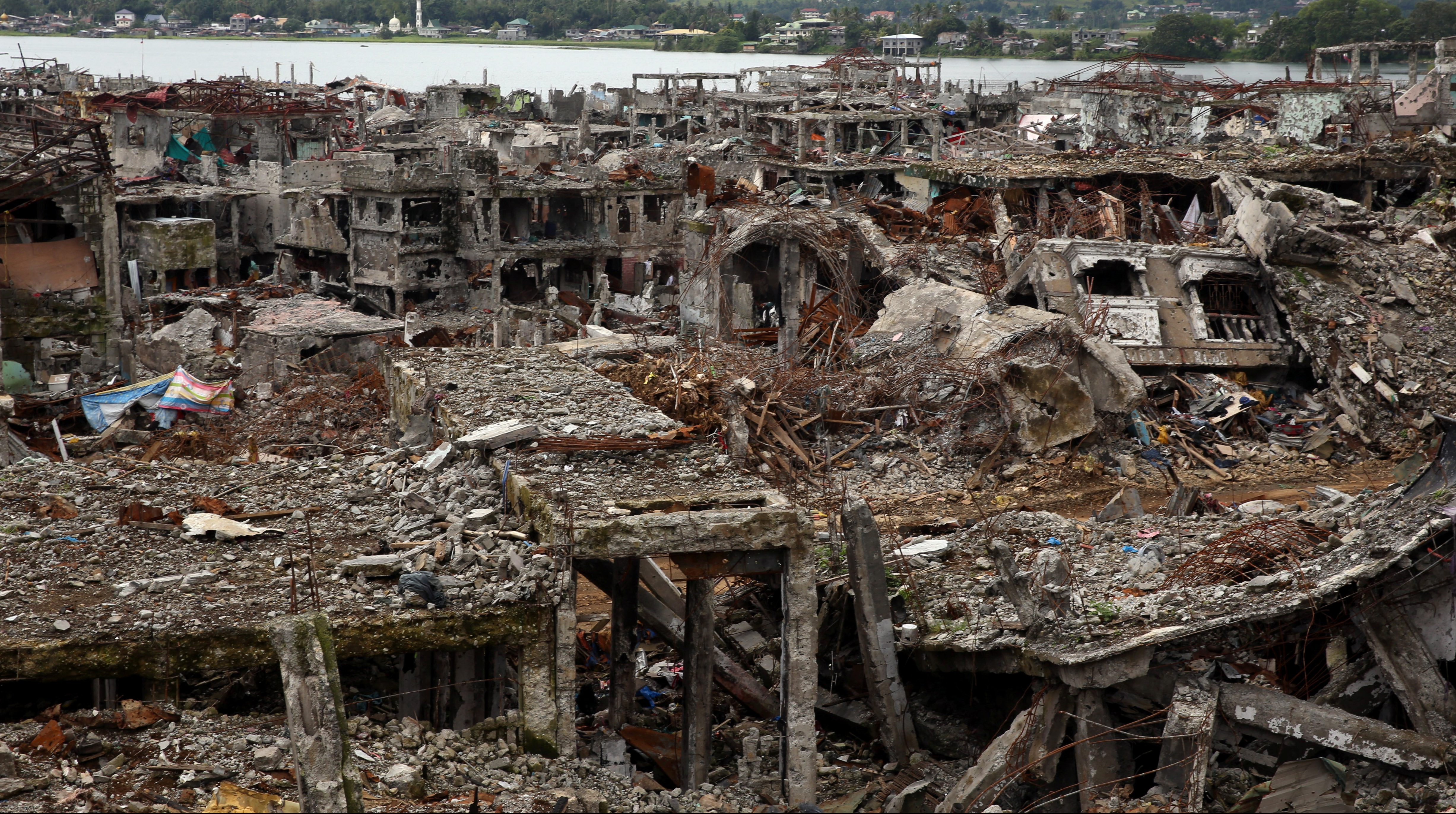 Damaged houses and buildings are seen in Marawi city, southern Philippines October 25, 2017.