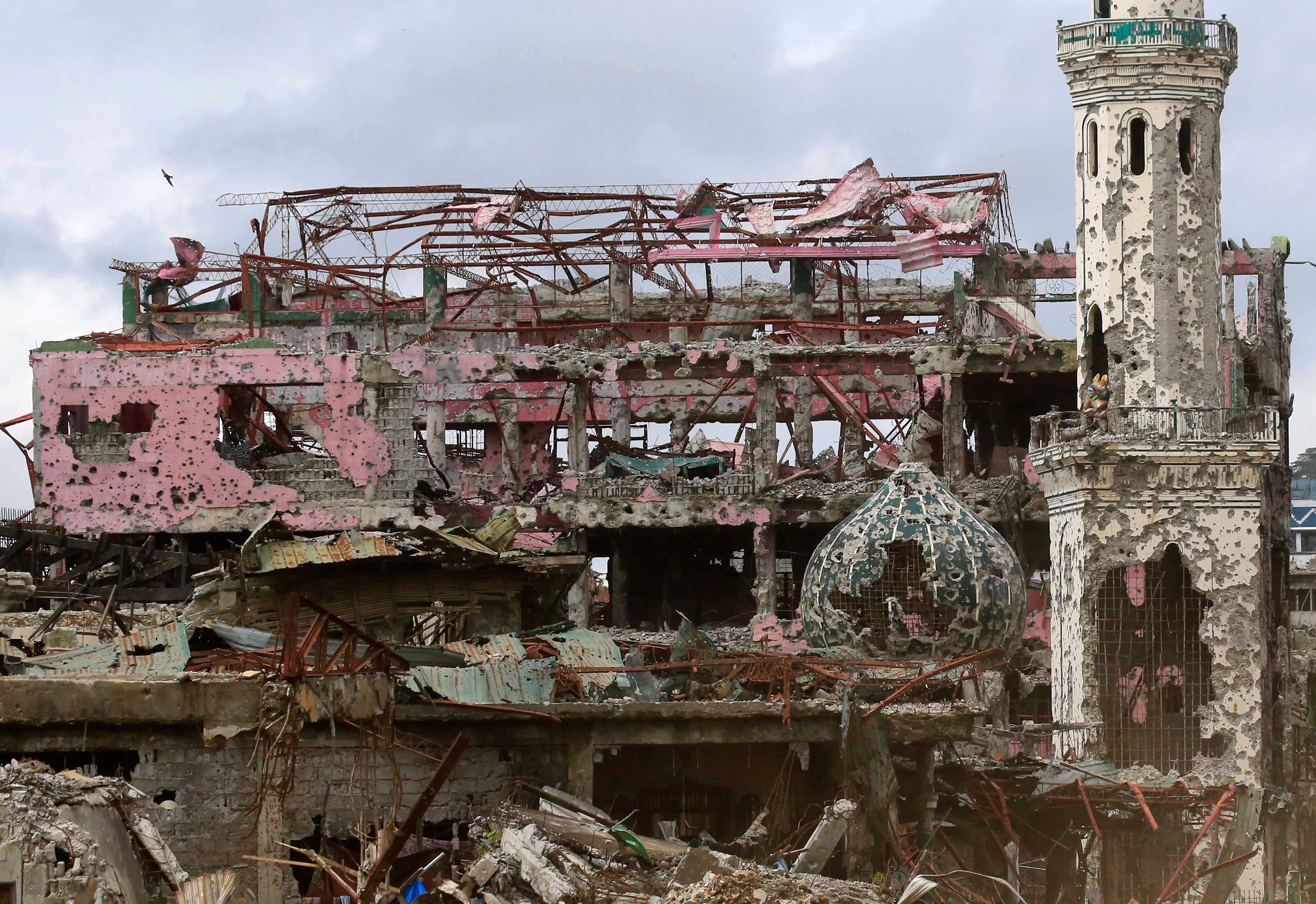 Damaged houses, buildings, and a mosque are seen inside Marawi city, Philippines, October 25, 2017.