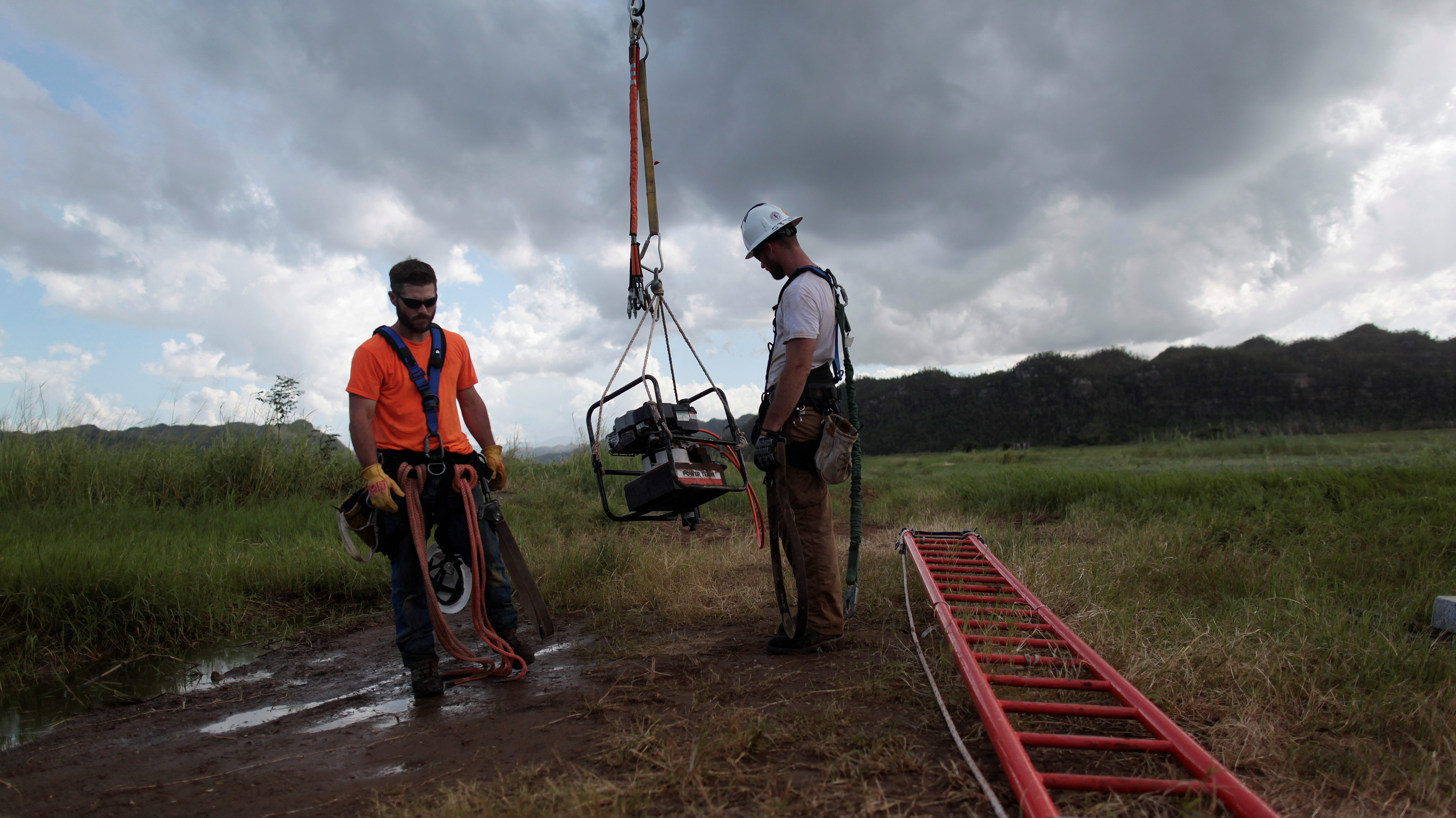 Workers from Montana-based Whitefish Energy Holdings help fix the island's power grid, damaged during Hurricane Maria in September, in Manati