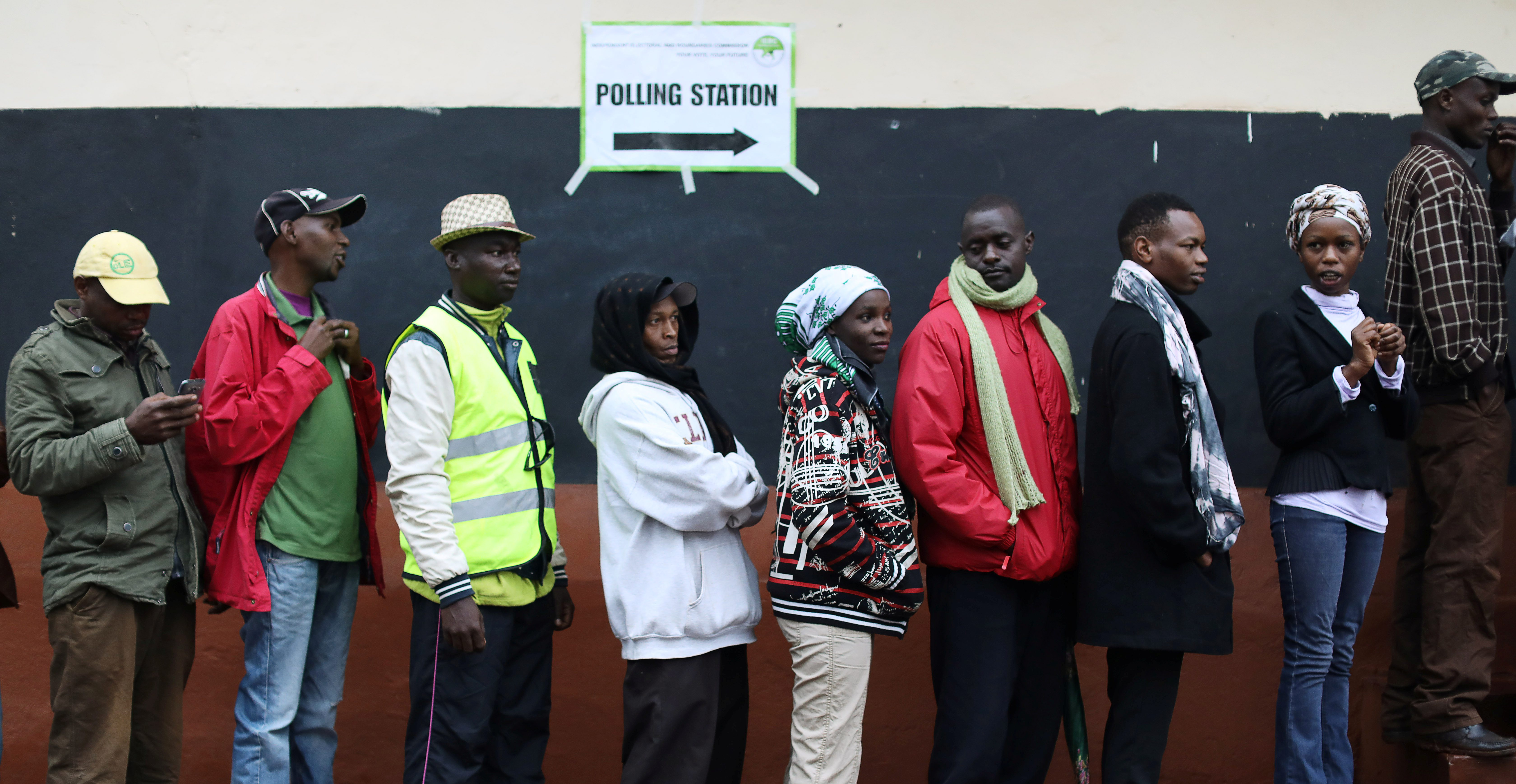 People queue to cast their vote at a polling station during a presidential election re-run in Gatundu, Kenya October 26, 2017.
