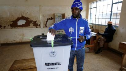 A man casts his vote at a polling station during a presidential election re-run in Nairobi, Kenya October 26, 2017.