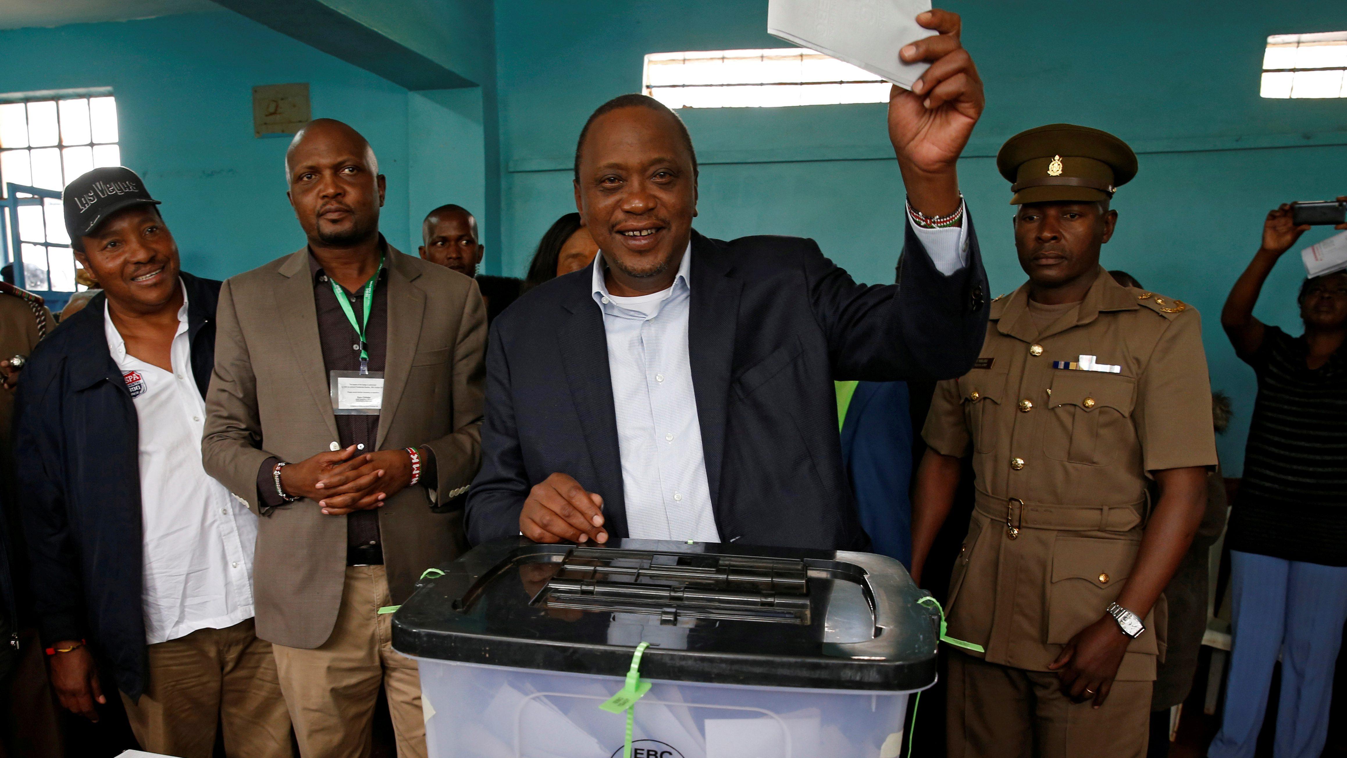 Kenya's President Uhuru Kenyatta casts his vote during a presidential election re-run in Gatundu, Kenya October 26, 2017.