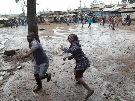 Opposition supporters throw stones at police during clashes in Kibera slum in Nairobi, Kenya October 26, 2017.