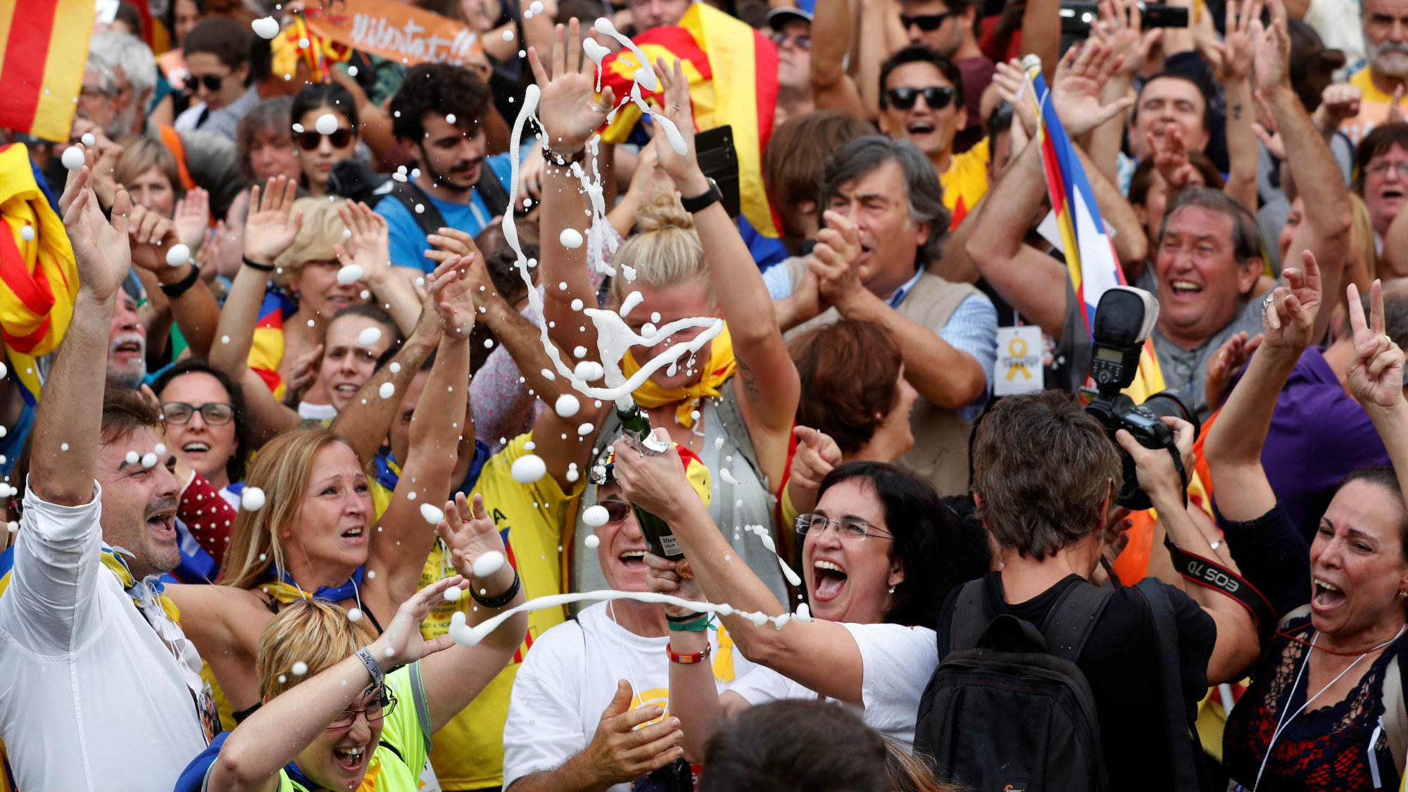 People celebrate after the Catalan regional parliament passes the vote of independence from Spain in Barcelona, Spain October 27, 2017