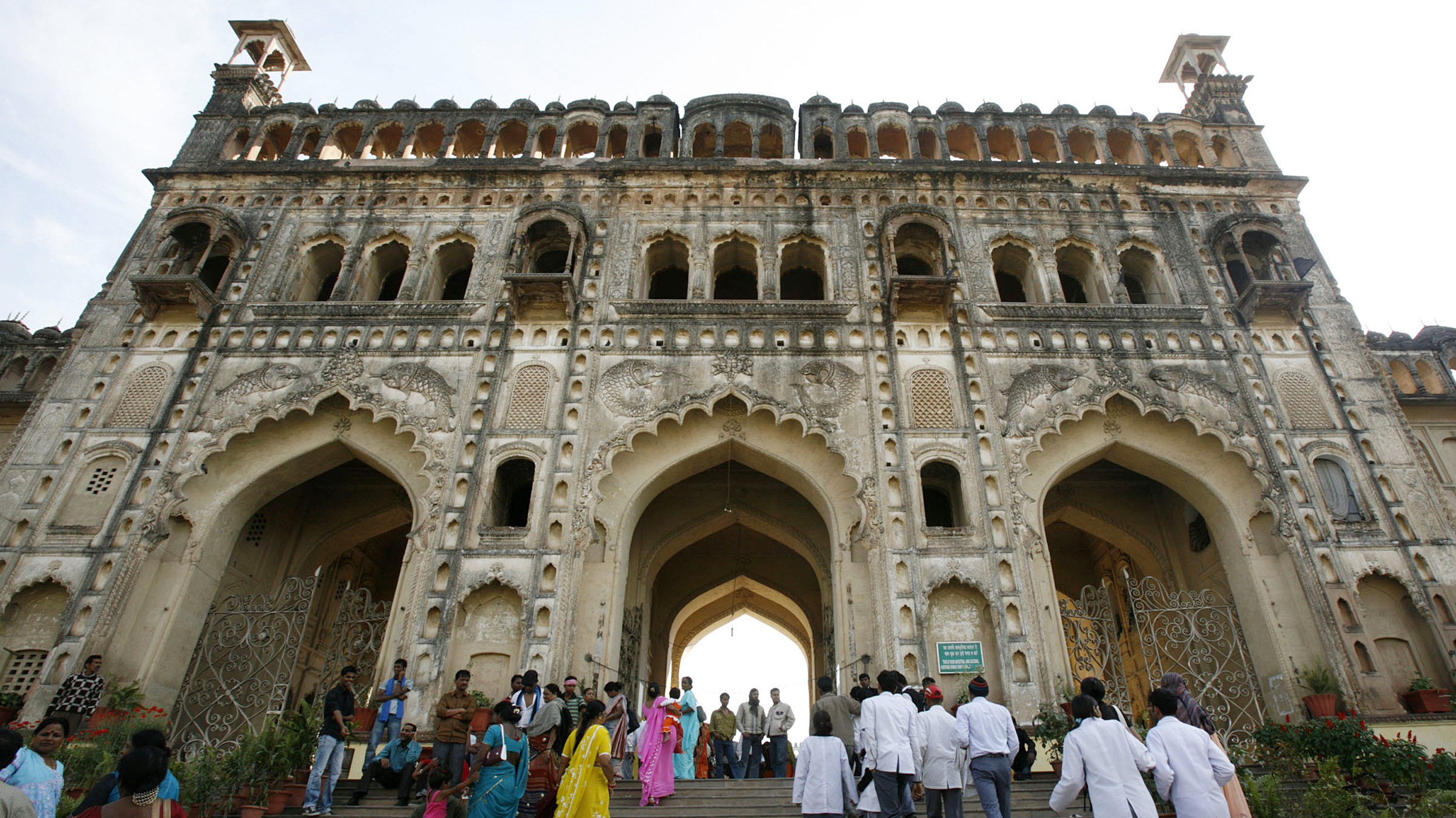 Visitors walk towards the main entrance of the Asafi Imambara monument, also known as Bara Imambara, in the northern Indian city of Lucknow