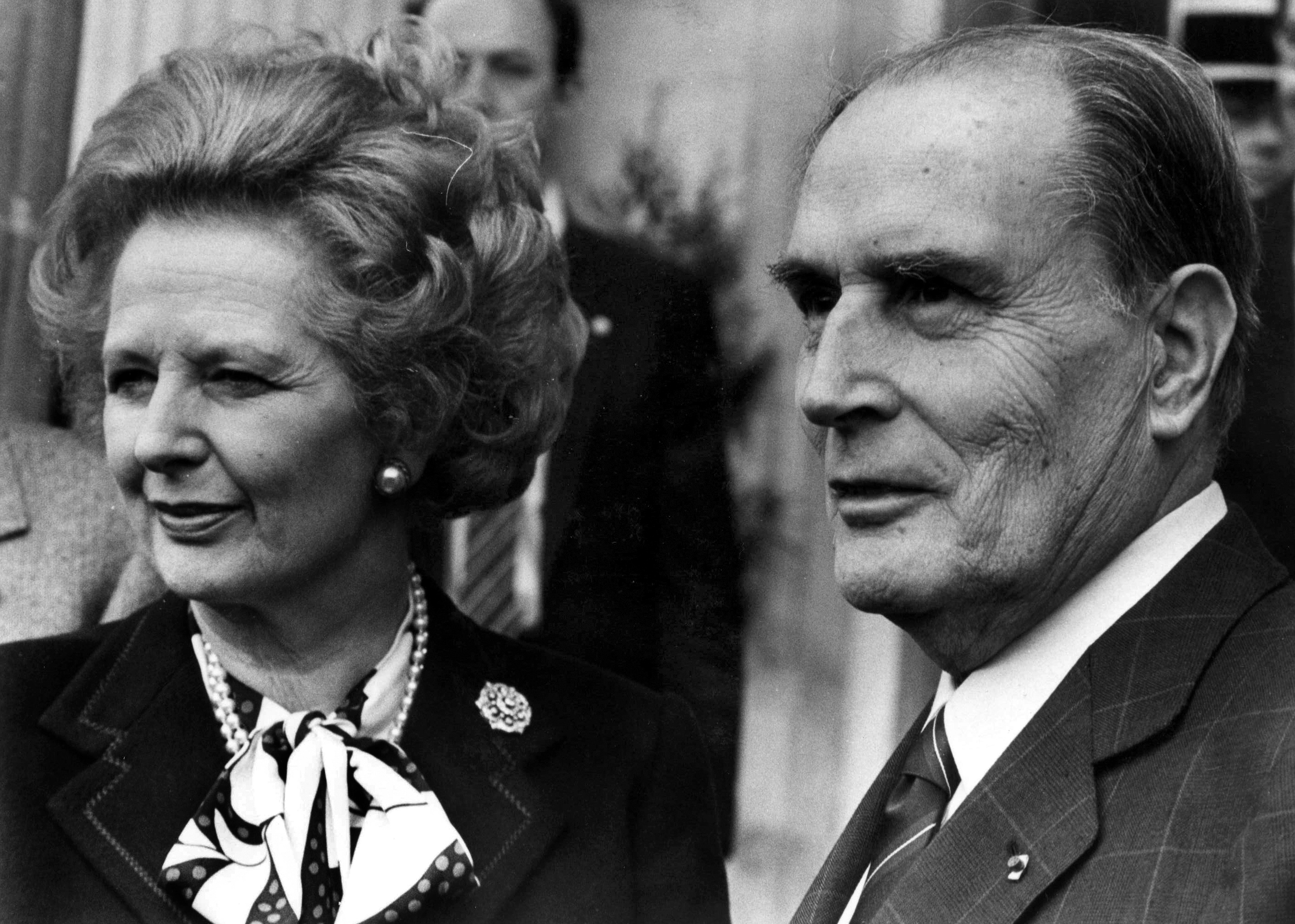 British Prime Minister Margaret Thatcher (L) and French President Francois Mitterrand pose for the media after a meeting about nuclear arms control at the Chateau de Benouville in Normandy, western France, March 23, 1987.   (FRANCE) - PM1E53A1FQJ01
