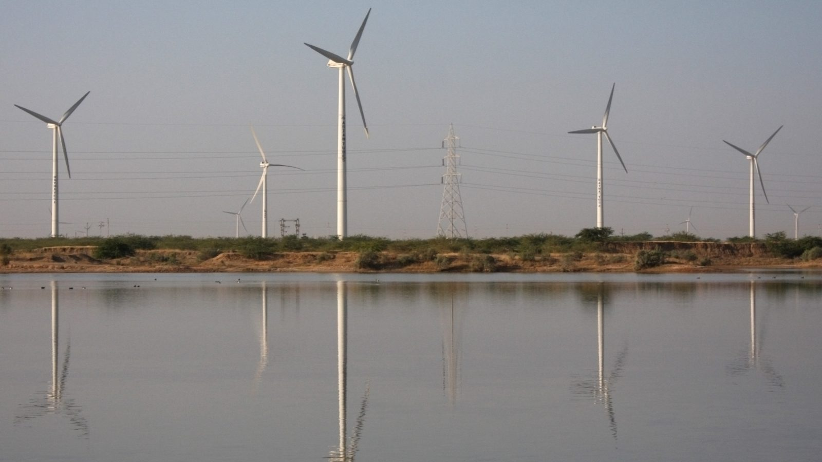 A view of power generating wind turbines at Suzlon wind farm in Surajbari village, about 275 km (171 miles) west of the western Indian city of Ahmedabad December 14, 2009. REUTERS/Amit Dave (INDIA - Tags: ENERGY ENVIRONMENT BUSINESS POLITICS) - GM1E5CF02TM01