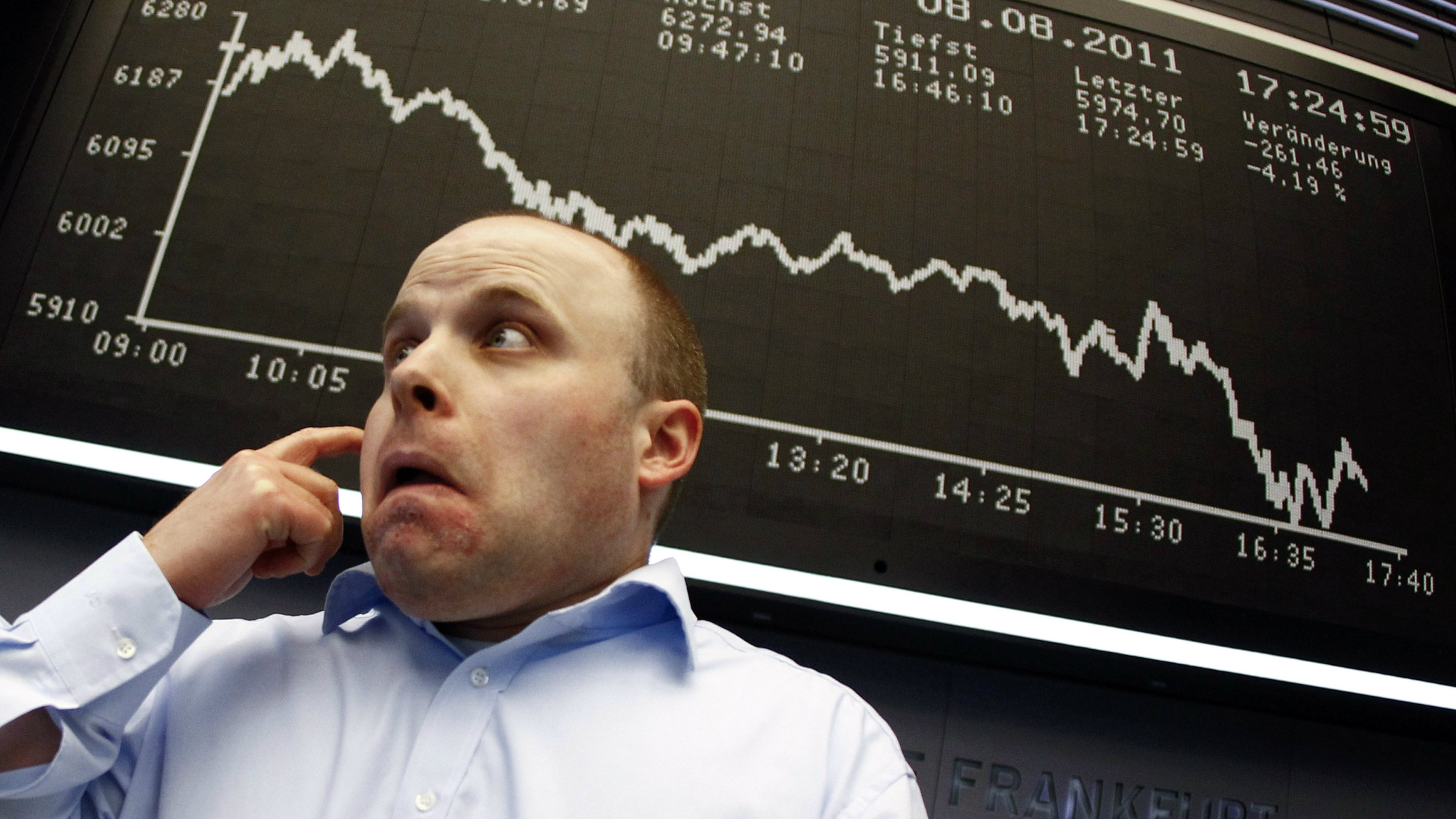 A trader reacts in front of the DAX index board at Frankfurt's stock exchange August 8, 2011. Germany's DAX fell 4.5 percent to below 6,000-mark for the first time since September 2010.