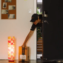 Amazon Key courier delivers a package into your home.