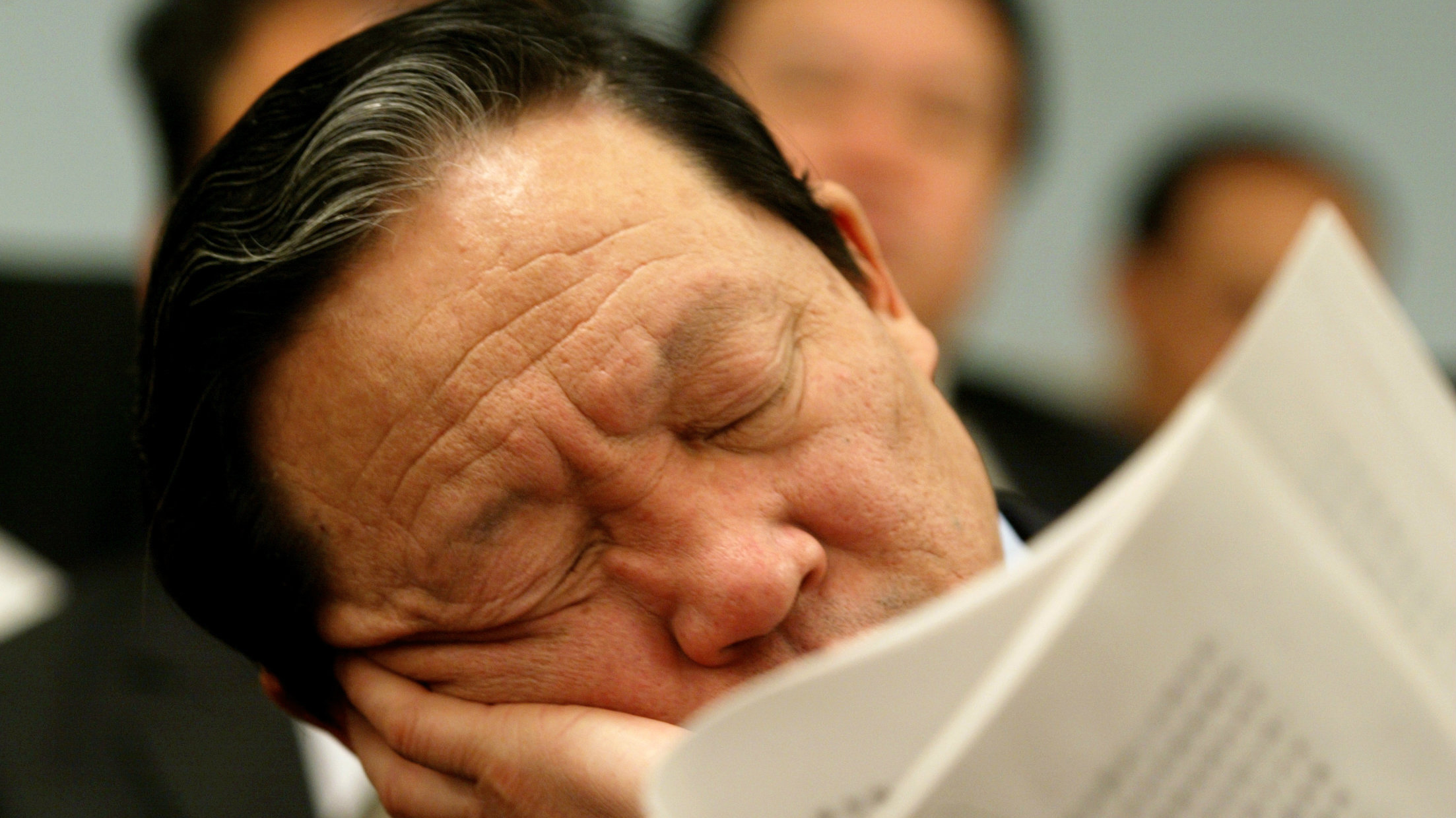 A delegation member sleeps during the opening session of the National People's Congress (NPC), or parliament, at the Great Hall of the People in Beijing March 5, 2003. The NPC began on Wednesday in China's capital, when China's new leadership will take up their positions. The Congress will end on March 18.