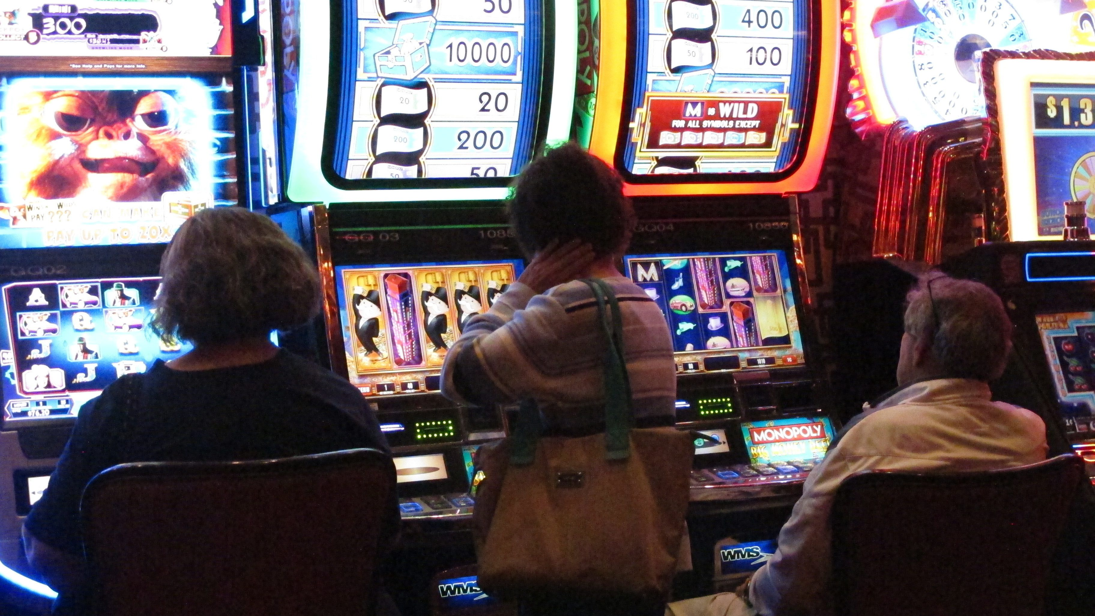 This June 24, 2016 photo shows a gamblers playing slot machines at the Golden Nugget casino in Atlantic City N.J. Figures released on Friday, May 12, 2017 show that the Golden Nugget had the highest gambling revenue increase in April of Atlantic City's seven casinos, up more than 17 percent from a year ago. (AP Photo/Wayne Parry)