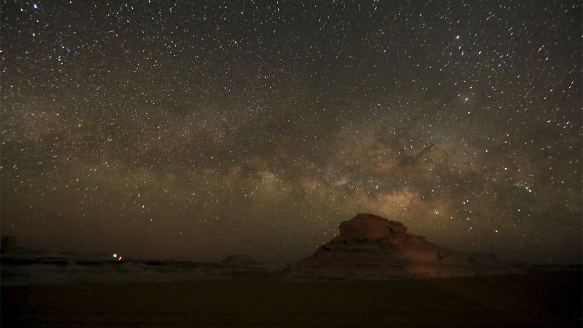 The 'Milky Way' is seen in the night sky over rocks in the White Desert north of the Farafra Oasis southwest of Cairo May 15, 2015. The White Desert, about 500 km southwest of the Egyptian capital Cairo, features limestone and chalk forms strangely shaped by the wind and sand, a terrain that gains in intensity when illuminated by the moon. Slightly to the north lies the Black Desert, given its name by the volcanic rock dolerite, similar to basalt. Four-by-four and trekking trips for tourists include Bedouin music around campfires and nights slept under a breathtaking array of stars