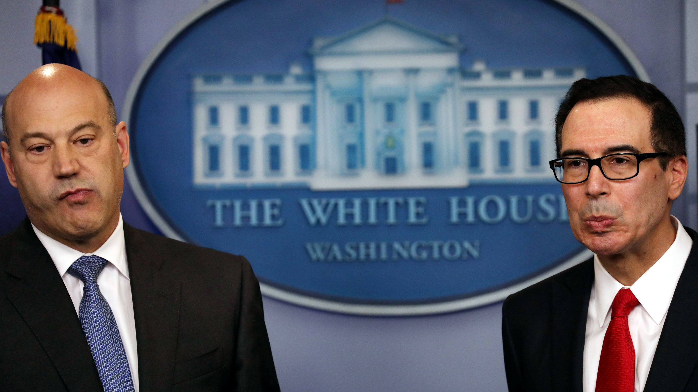 U.S. National Economic Director Gary Cohn (L) and Treasury Secretary Steven Mnuchin react to questions while unveiling the Trump administration's tax reform proposal in the White House briefing room in Washington, U.S, April 26, 2017.