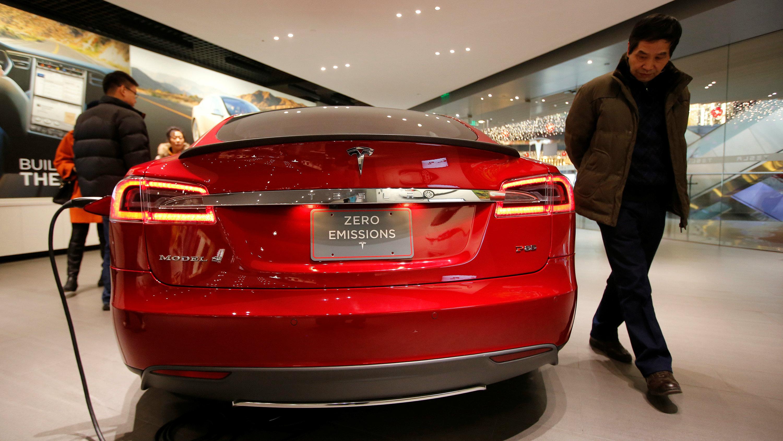 A man looks at Tesla Motors' Model S P85 at its showroom in Beijing January 29, 2014.