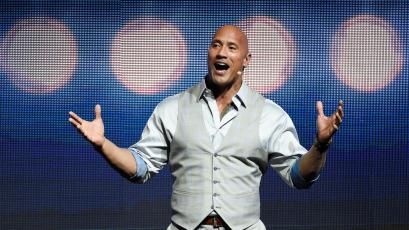"""Dwayne Johnson, a cast member in the upcoming film """"Baywatch,"""" addresses the audience during the Paramount Pictures presentation at CinemaCon 2017 at Caesars Palace on Tuesday, March 28, 2017, in Las Vegas. (Photo by Chris Pizzello/Invision/AP)"""