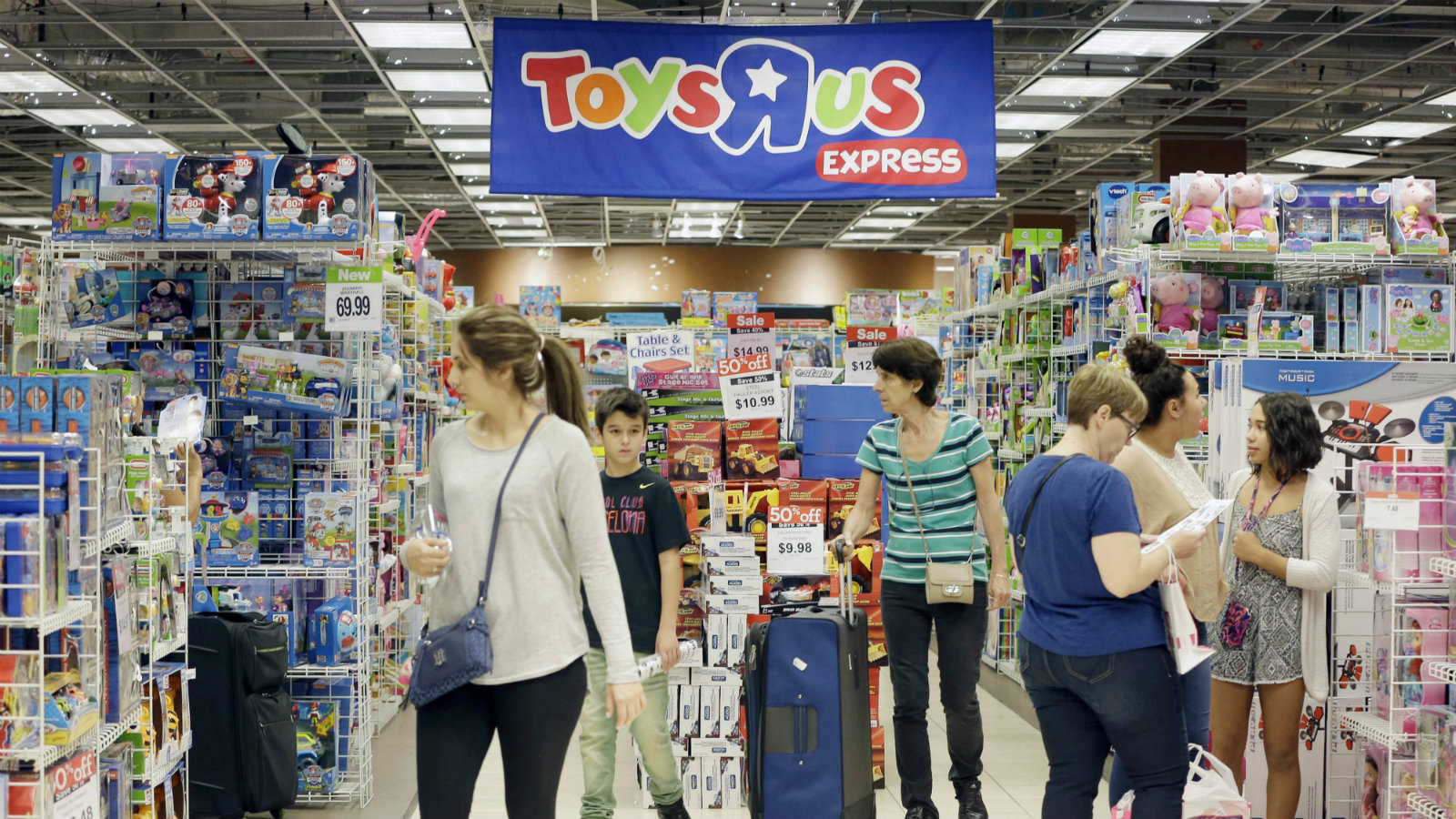 Shoppers shop in a Toys R Us store on Black Friday, Nov. 25, 2016, in Miami. Stores open their doors Friday for what is still one of the busiest days of the year, even as the start of the holiday season edges ever earlier